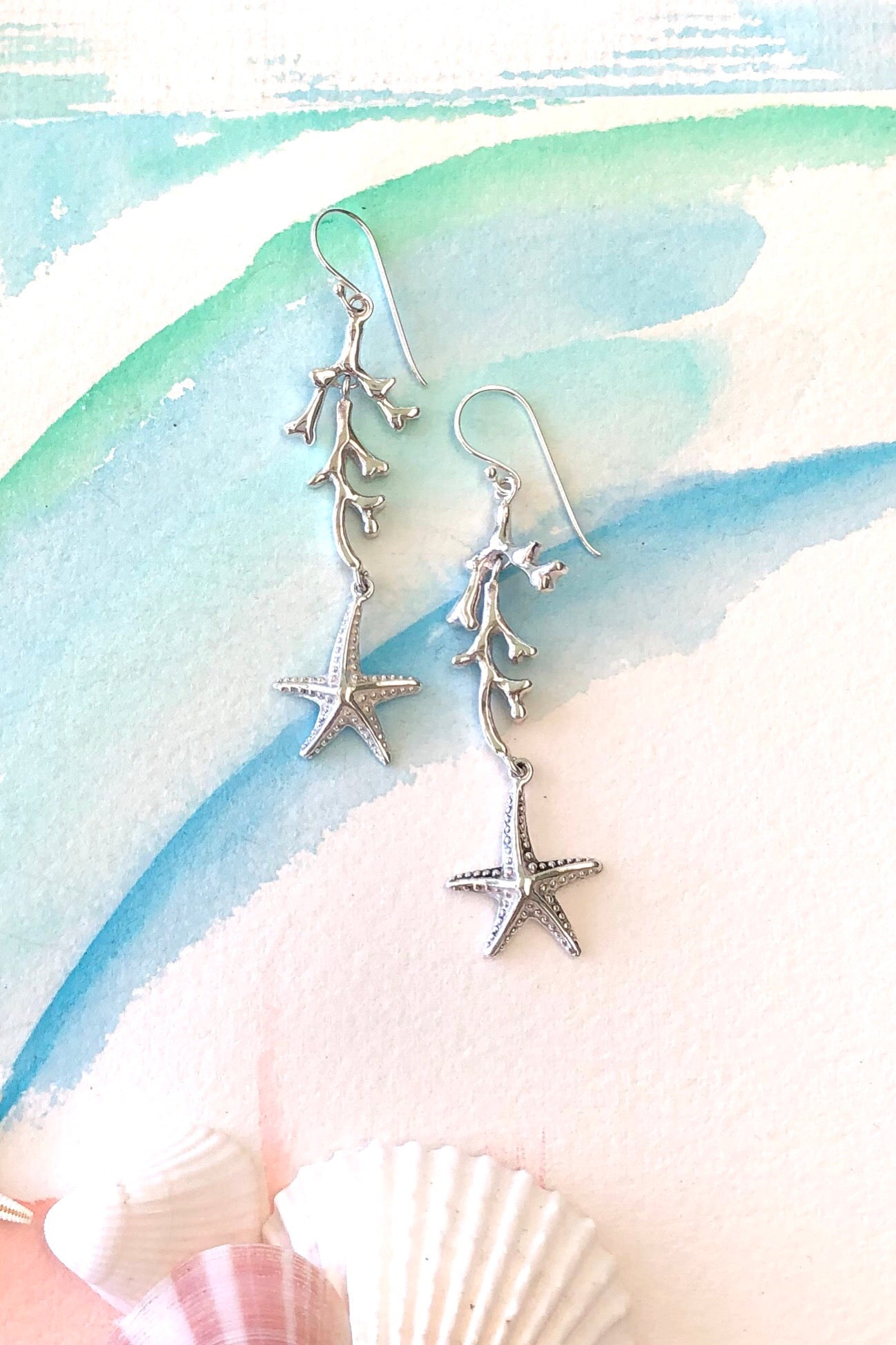 Dainty and feminine 925 silver drop earrings featuring coral and seashells