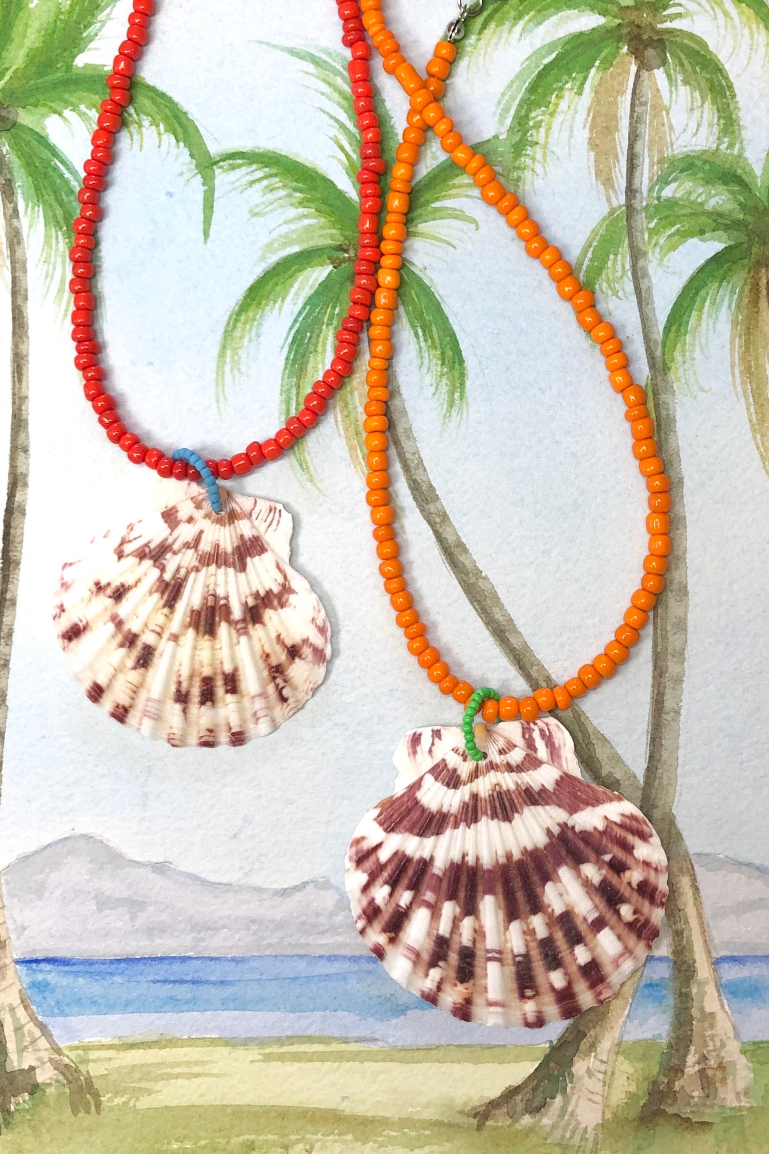 these collected sea shells all carry different patterns, no two ever alike and you can swim in this! its strung on amazingly red glass beads.