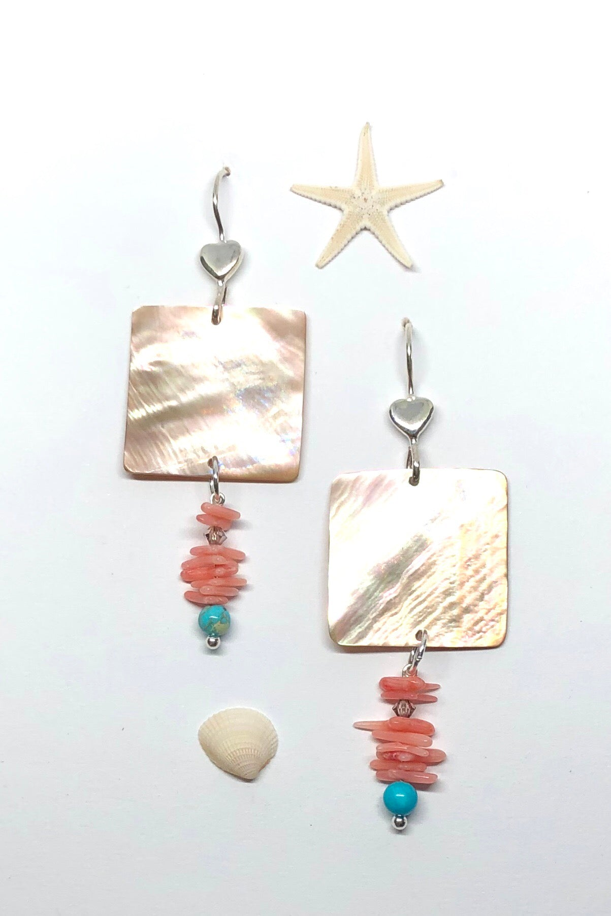 A delicately shimmering Golden mother of pearl square drop from a pretty silver hook