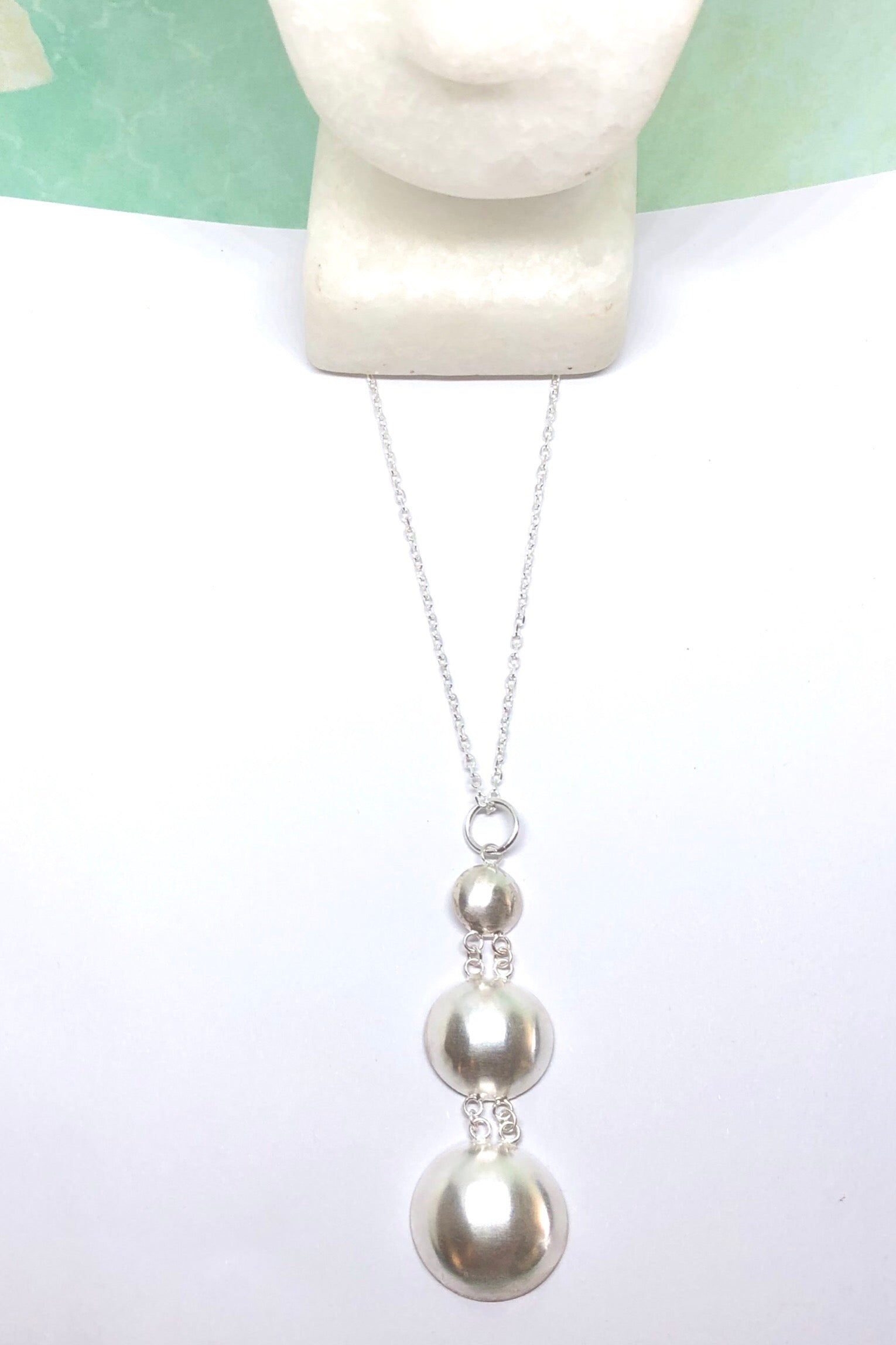 Silver pendant designed in African chic modern style.