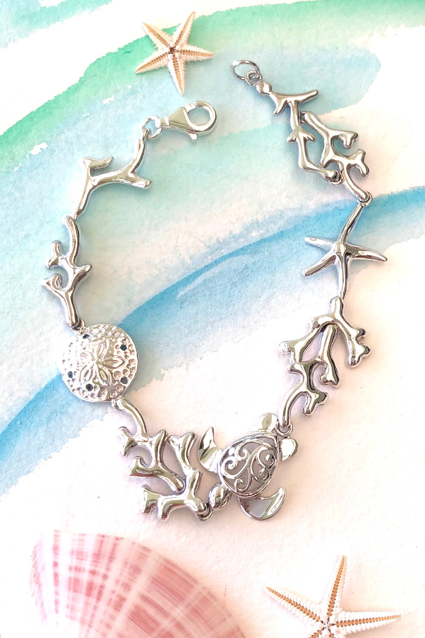 925 solid silver symbols of the sea all connected around the wrist