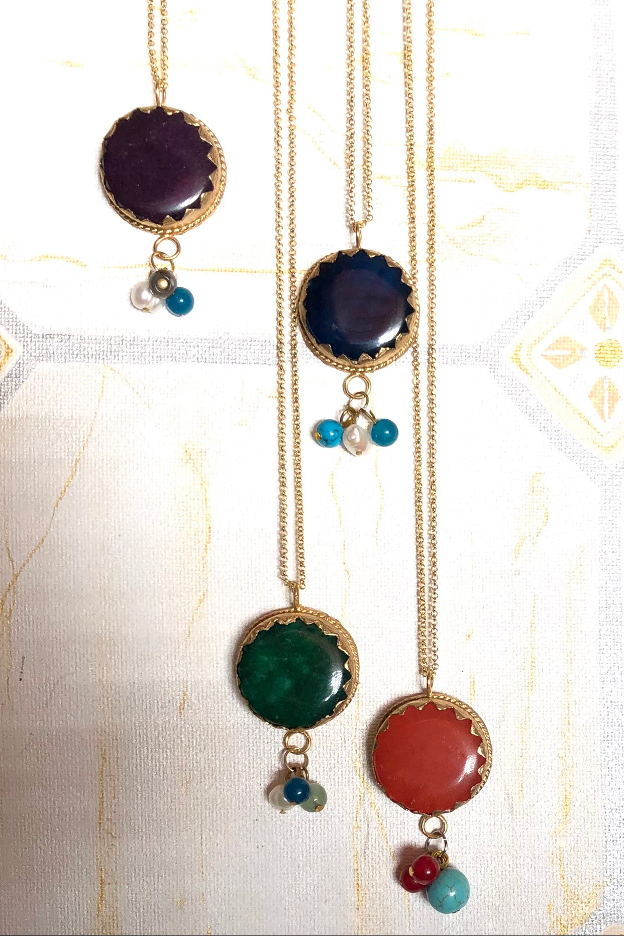These cheerful pendants are made for wearing this summer! A bright pop of colour held by an antiqued gold tone bezel.
