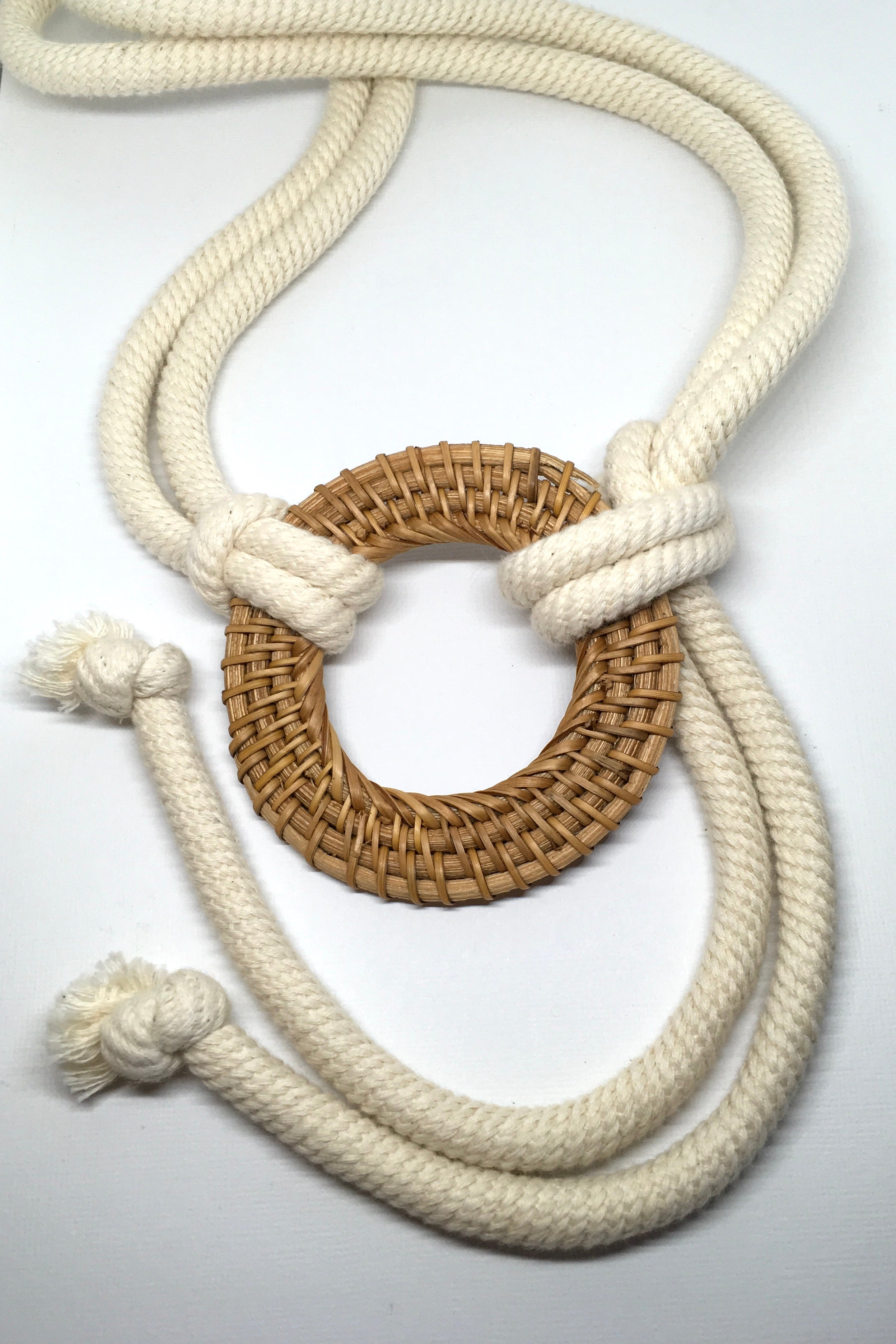 A thick cream rope with a natural tan rattan belt loop