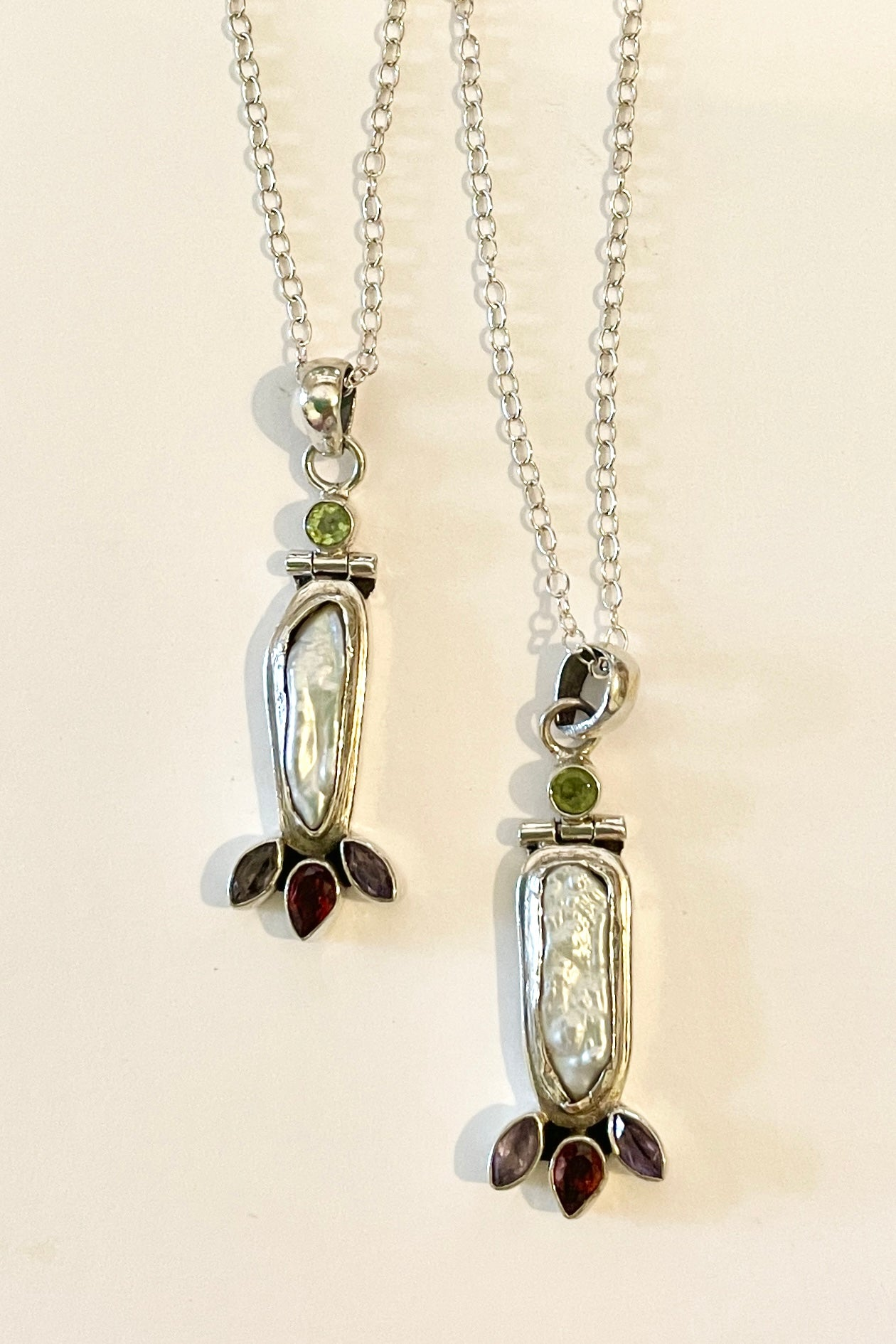 unusual handmade pendant featuring a freshwater pearl rim set in solid 925 silver