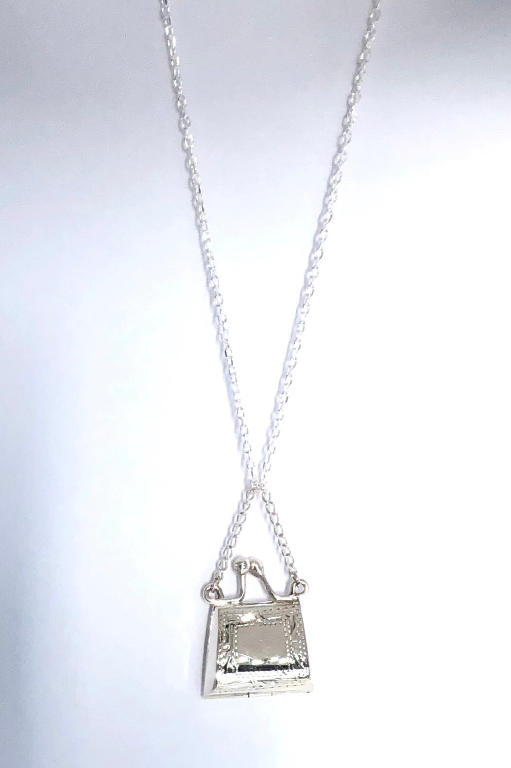 Pendant Locket Purse is a purse shaped locket that opens, 925 solid silver, pendant is 3cm long and comes on a 925 silver chain.