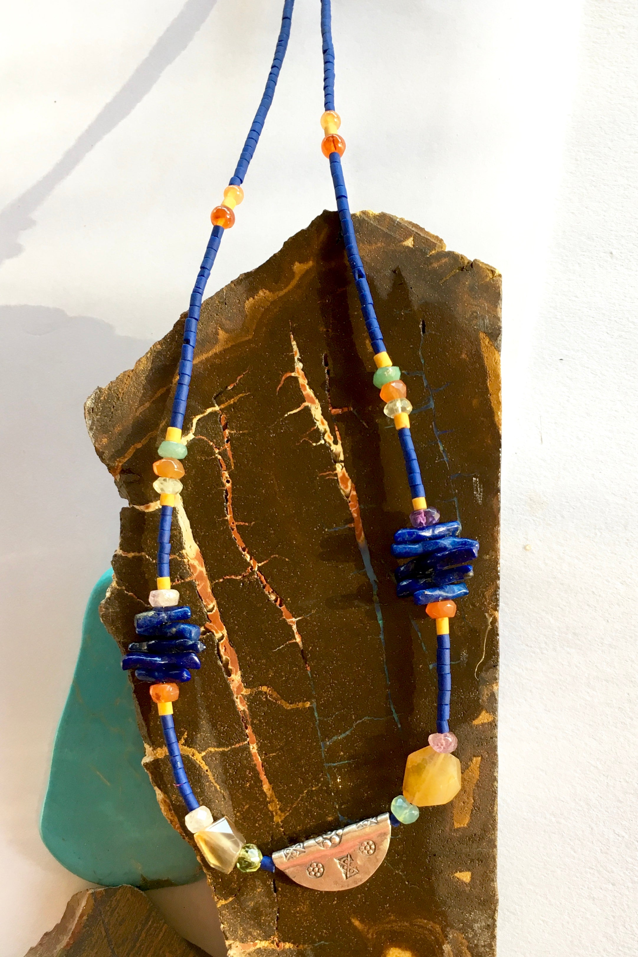 Necklace Cay Amulet with Lapis Lazuli is 40cm in length Beads include Lapis Lazuli, carnelian, faceted semi precious stone and Turkish glass beads.