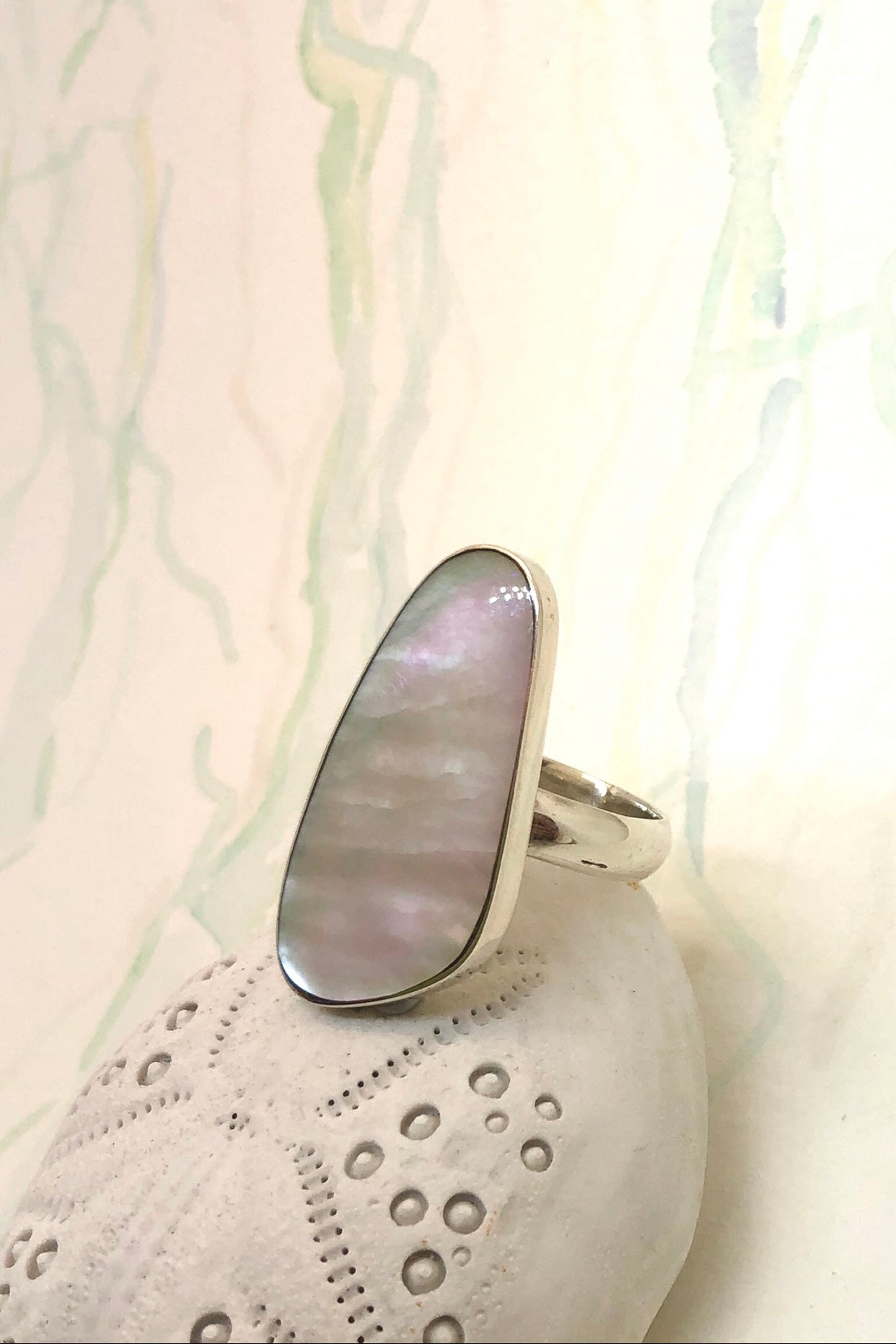 Echo Ring Mother of Pearl Freeform 925 Silver is 925 silver, designer setting and ring band.