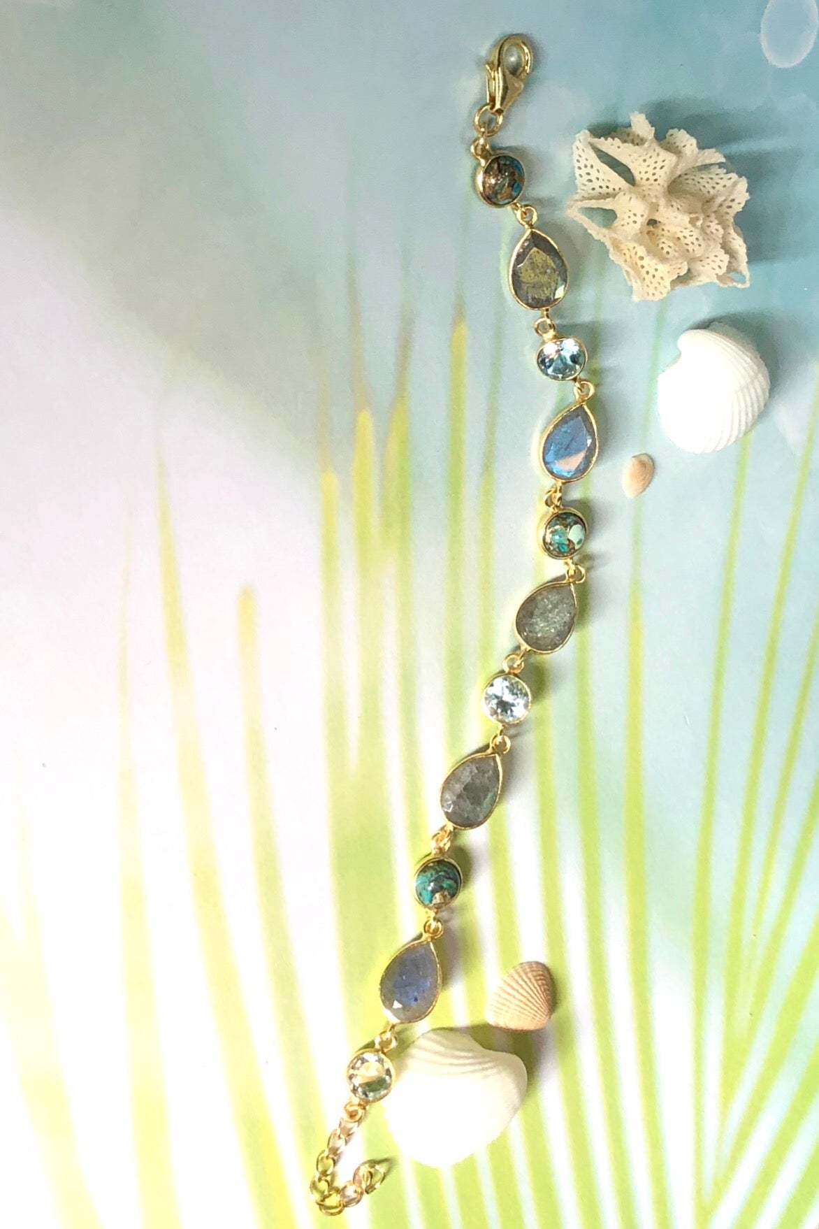 An ultra fine gold vermeil bracelet dotted with London blue Topaz, Labradorite and Turquoise composite.