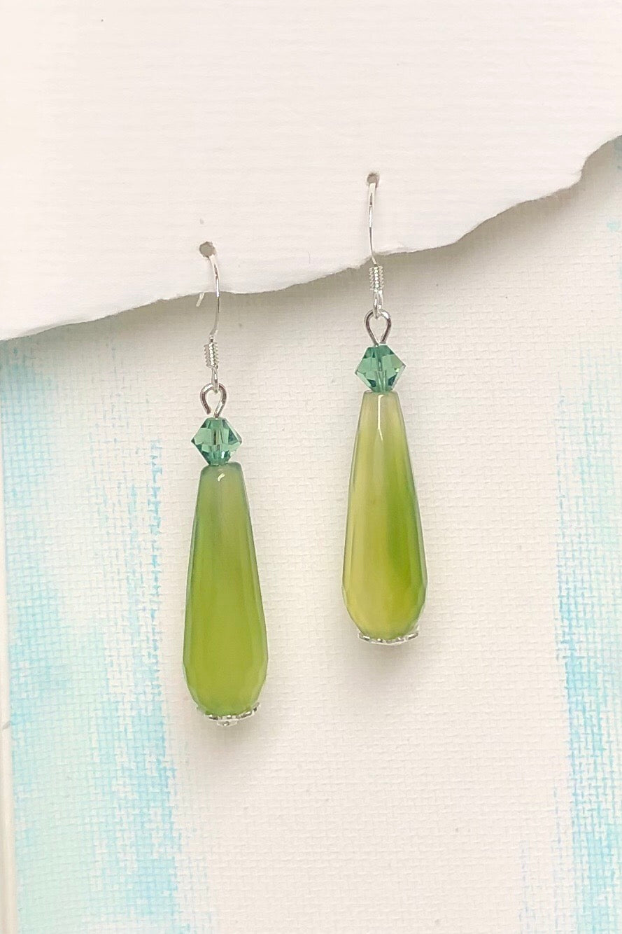 The Earrings Rock Droplet Sea Blue are beautiful drop style earrings featuring 925 silver hooks, Pale lime green teardrop shaped stone with a single green crystal on top.