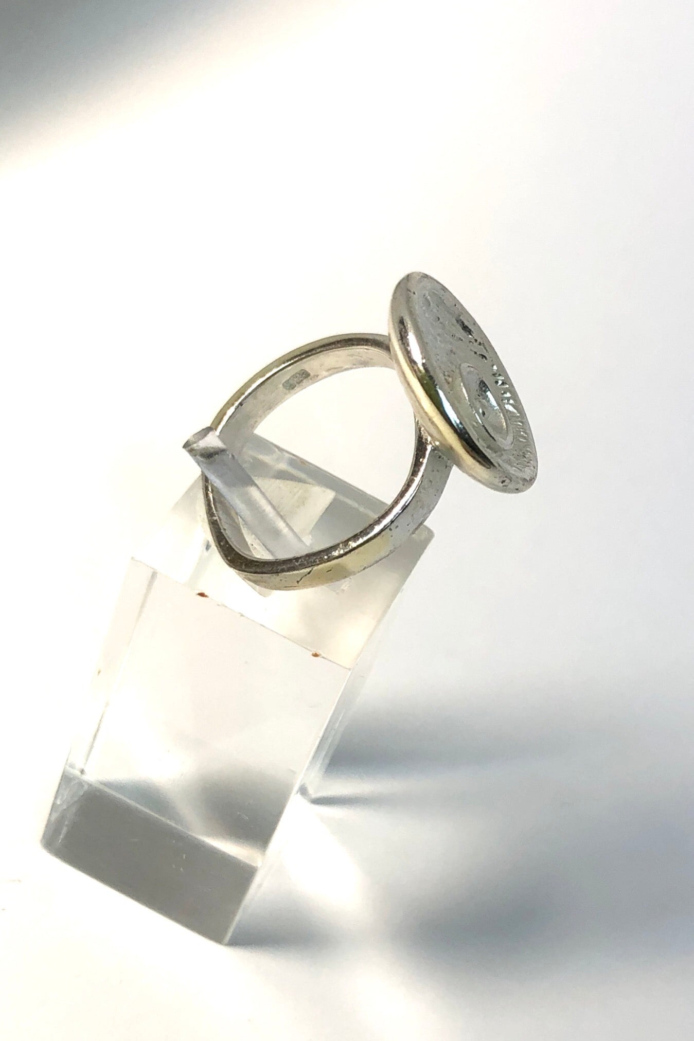 Echo Ring Circles 925 Silver is a simple circle of silver with organic detailing in a 925 silver setting.