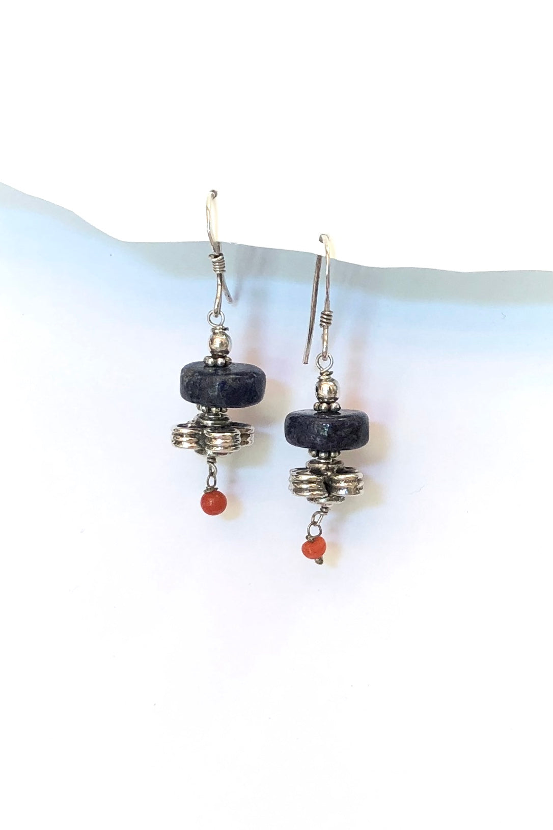 Echo Earrings Lapis and Coral are made of 925 silver with a circular Lapis Lazuli bead, a silver fancy bead and a little coral drop.