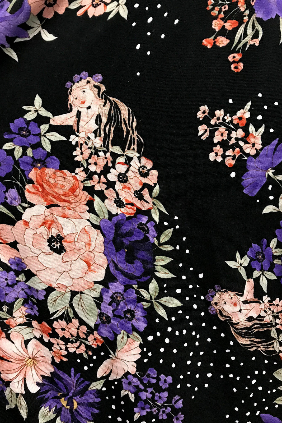 Fabric swatch of Adoro Mermaid Noir Maxi Dress featuring 100% rayon in black base with pink and purple floral print.