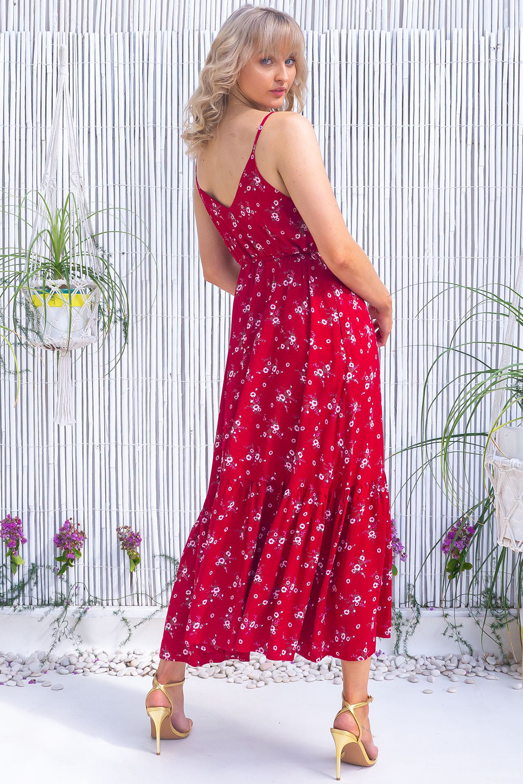 The Adoro Cherry Red Maxi Dress features bust area lined, V neck and back, drawstring under bust, thin straps, side pockets, frill at base of skirt and 100% rayon in rich red base scattered with a sweet, little floral print.