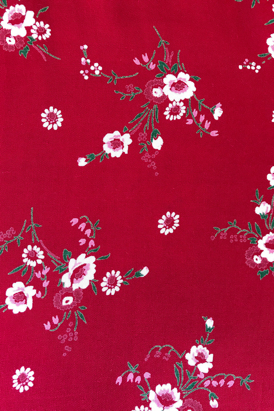 Fabric Swatch of Adoro Cherry Red Maxi Dress featuring 100% rayon in rich red base scattered with a sweet, little floral print.