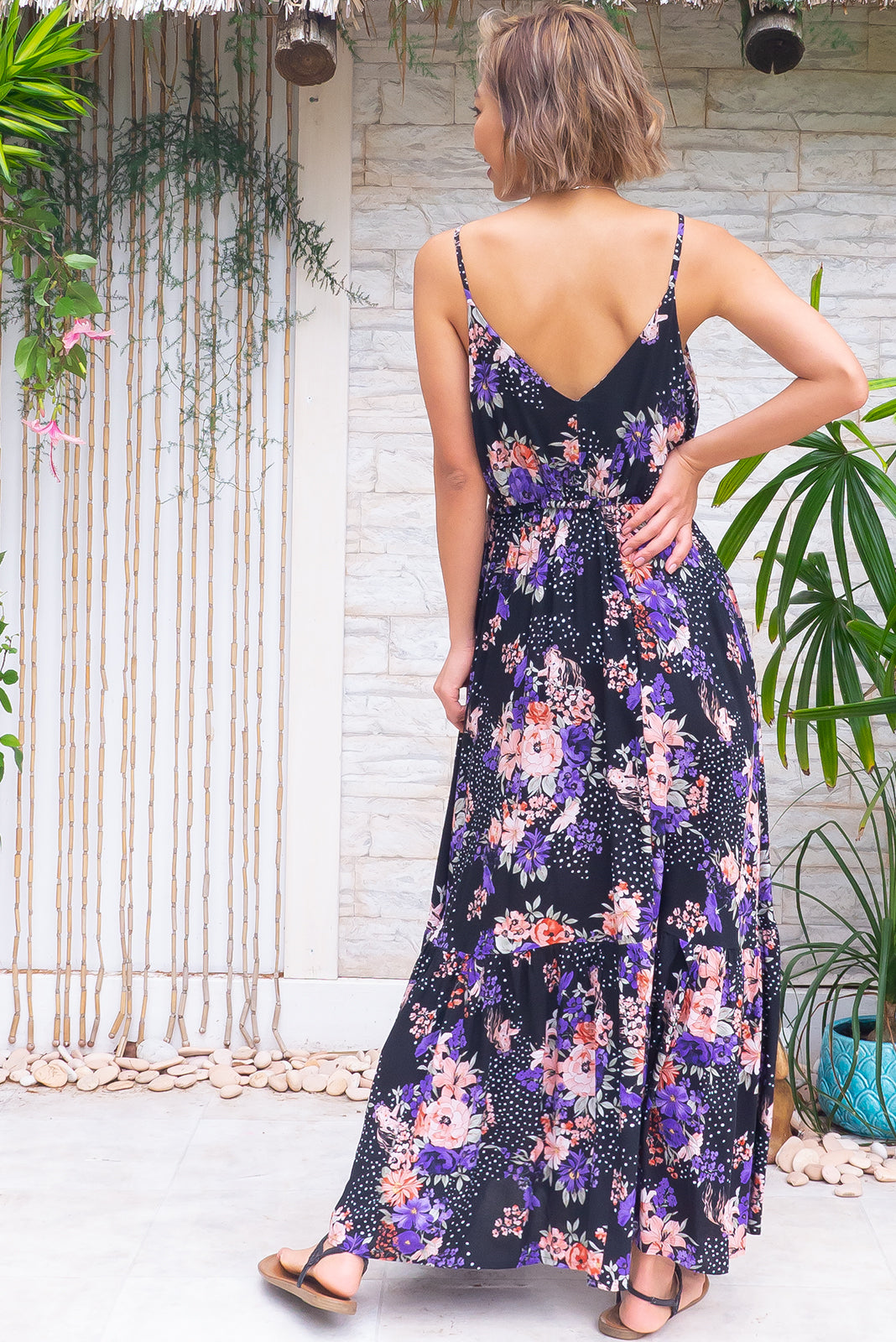 The Adoro Mermaid Noir Maxi Dress features fust area lined, V neck and back, elastic and drawstring under bust, thin straps, side pockets, frill at base of skirt and 100% rayon in black base with pink and purple floral print.