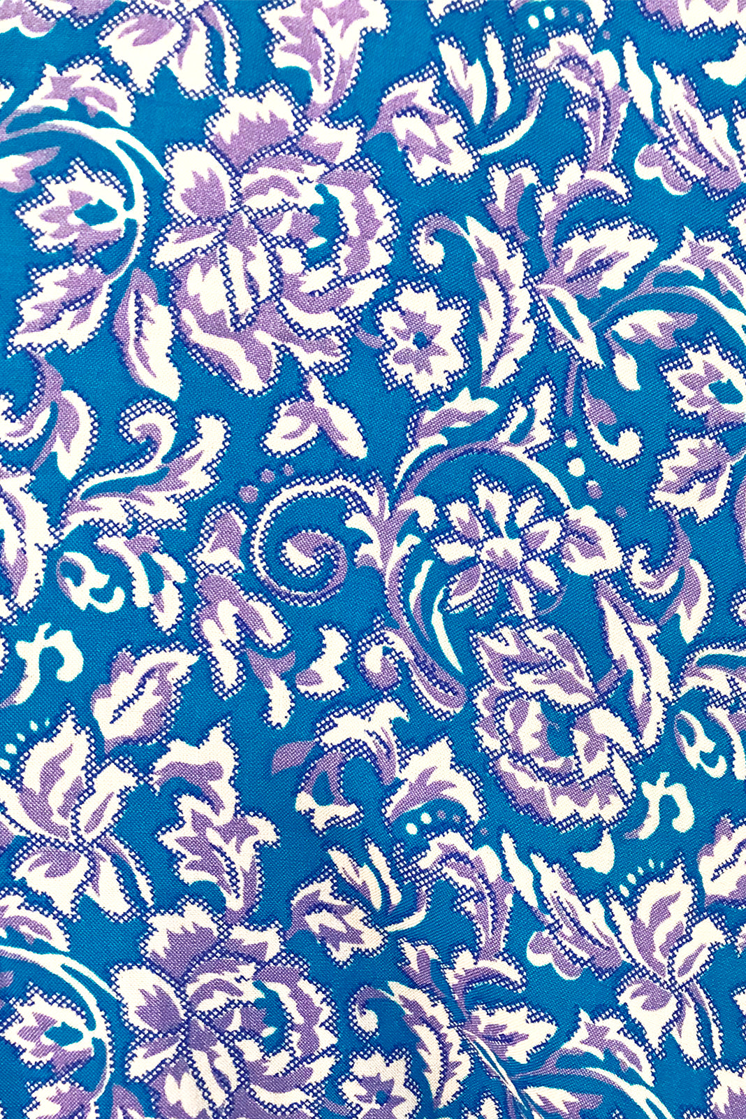 Fabric Swatch of Adoro Turquoise Fleur Maxi Dress featuring 100% rayon in blue base with white and purple floral print.