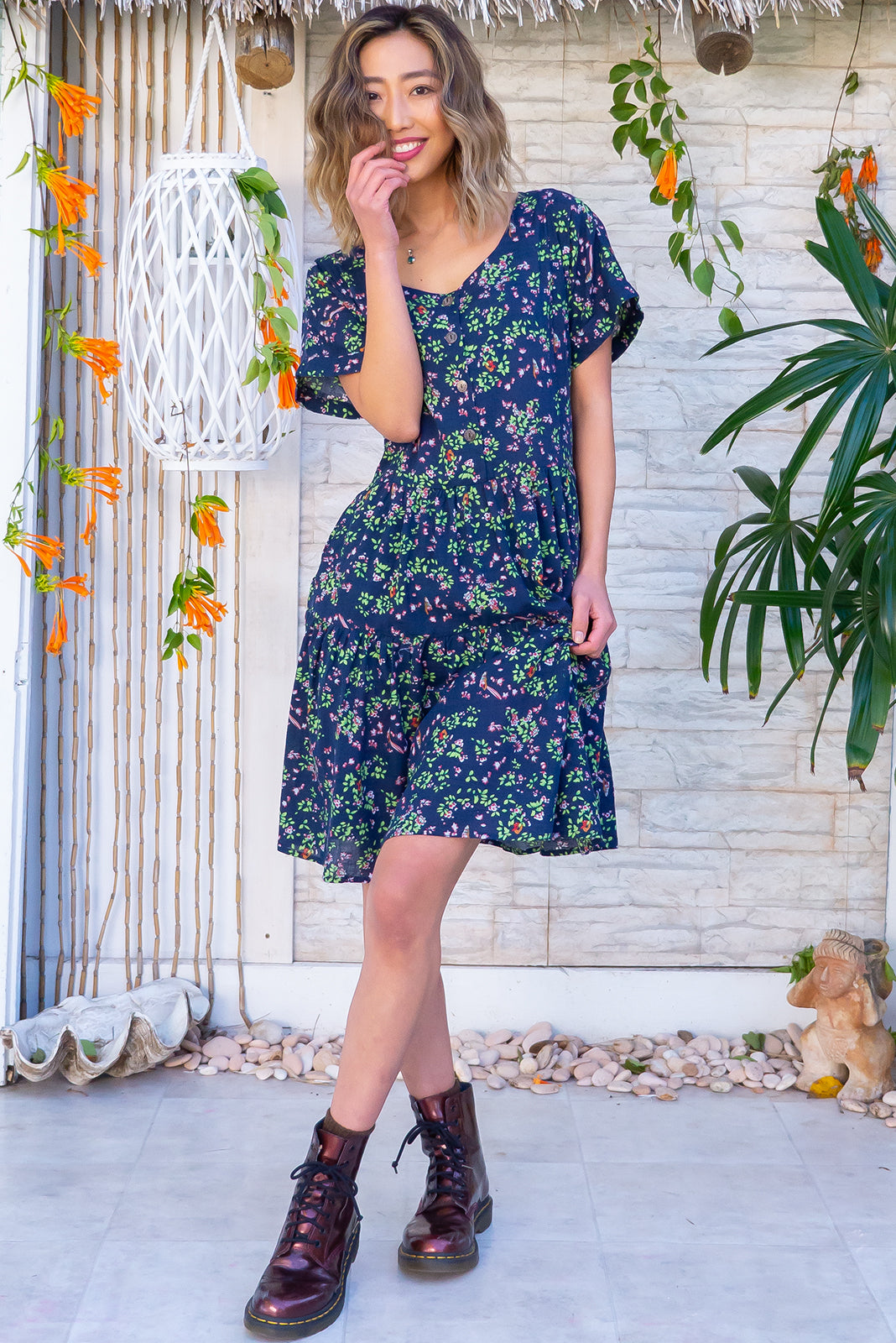 Airlie Navy Iris Mini Dress features functional button down chest to waistline, two-tiered gathered skirt, adjustable button plackets at back to cinch waist and woven 100% cotton in navy base with floral print.