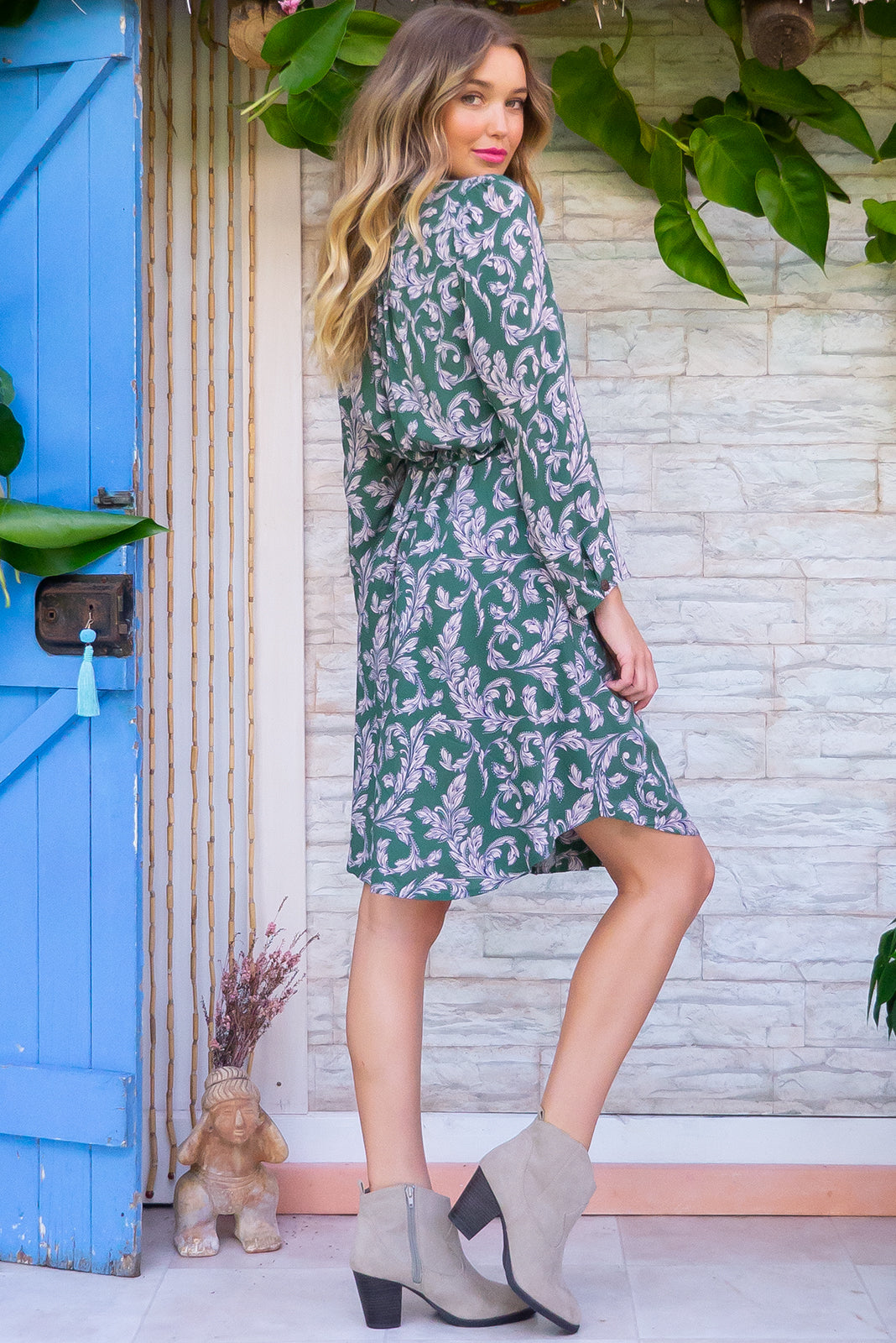 Alexandra Green Elysia Shirt Dress features a functional button front, long sleeve, drawstring waist and chic collar and it comes in a classic soft green and dark cream paisley print on 100% rayon