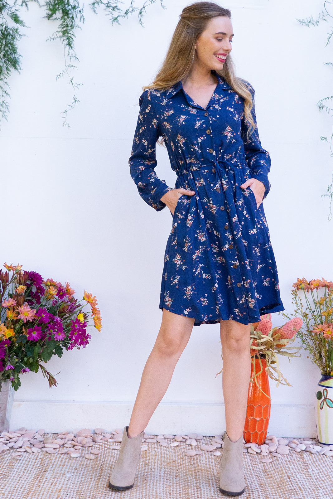 Alexandra Navy Skye Shirt Dress features a functional button front, long sleeve, drawstring waist and chic collar and it comes in a classic soft navy floral print on 100% rayon
