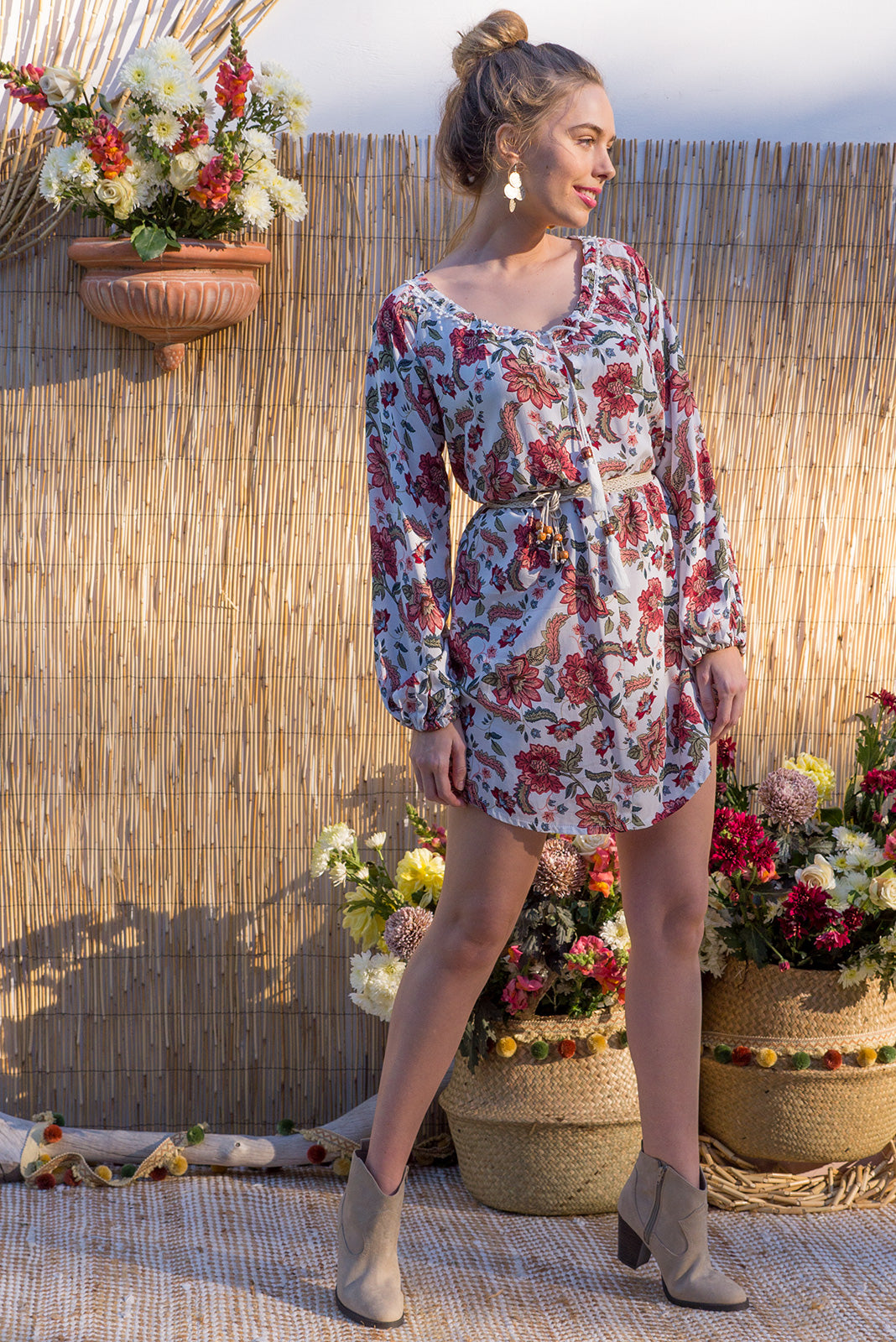 Amala Eastern Flower Dress features a wide adjustable neckline and a soft full length sleeve with elastic at the cuff and it comes in a boho inspired eastern flower print on soft woven rayon