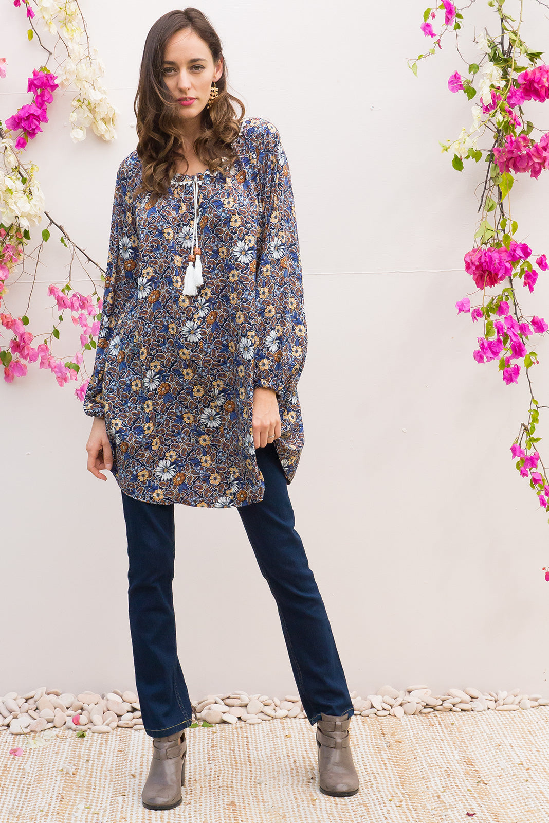 Amala Tunic Dress Vintage Daisy features a wide adjustable neckline and a soft full length sleeve with elastic at the cuff and it comes in a navy based vintage retro inspired flower print on soft woven rayon