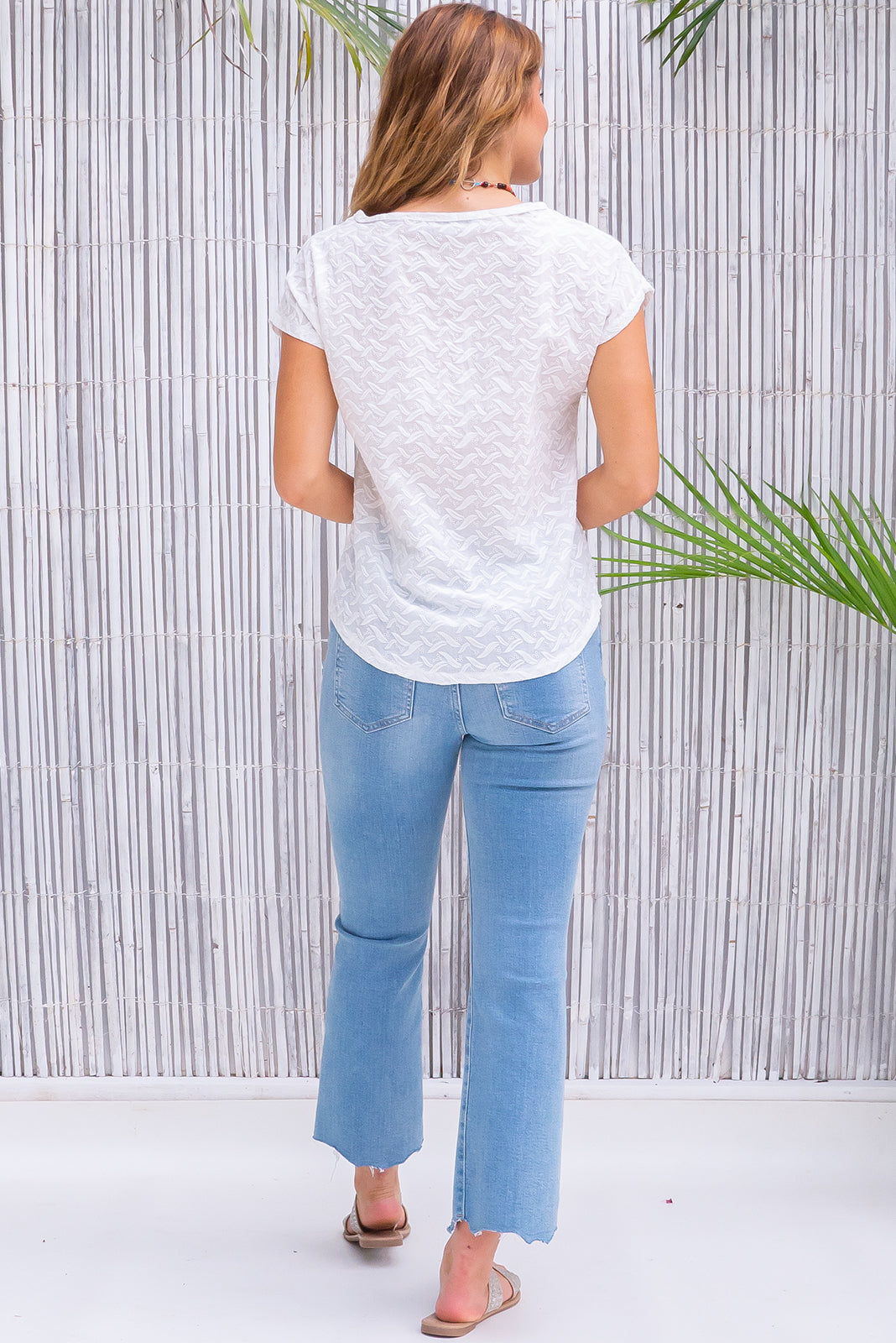 An intricate feather print embroidered on a crisp, 100% cotton T-shirt, the new Anglaise Top Feather Embroidery features lightweight/non-stretch/unlined, curved hem.