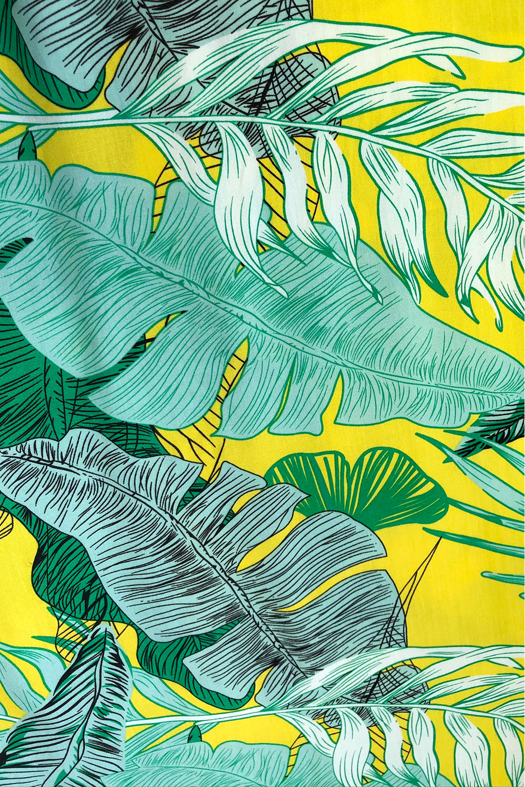 Fabric Swatch of Annabella Palm Gold Caftan Maxi Dress featuring 100% rayon in bright yellow base with green palm print.