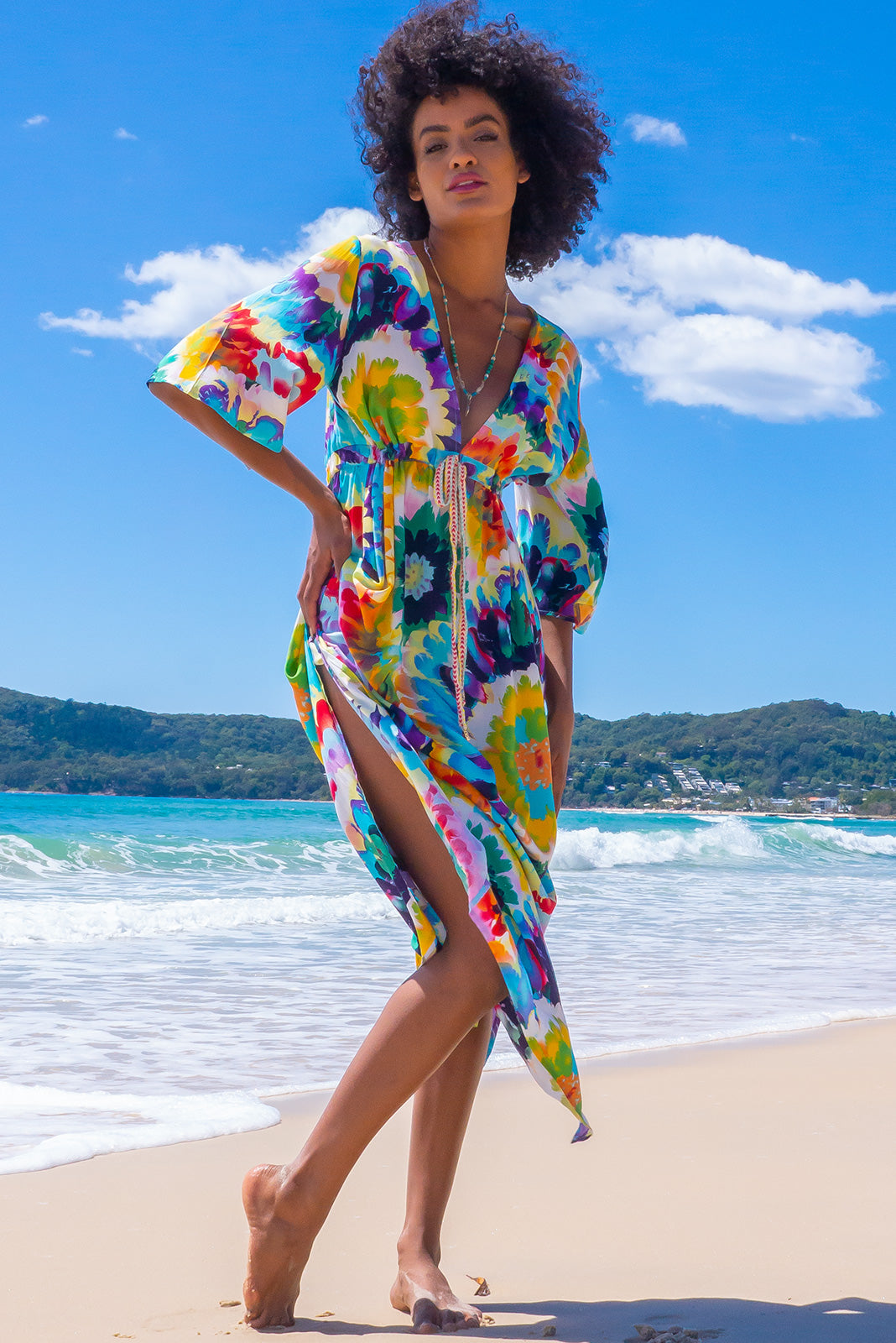The Annabella Wild Child Splash Caftan Maxi Dress features side pockets, elasticated waist back, braided multicoloured drawstring with tassels and beading and 100% rayon in white base with colourful tie dye inspired print.