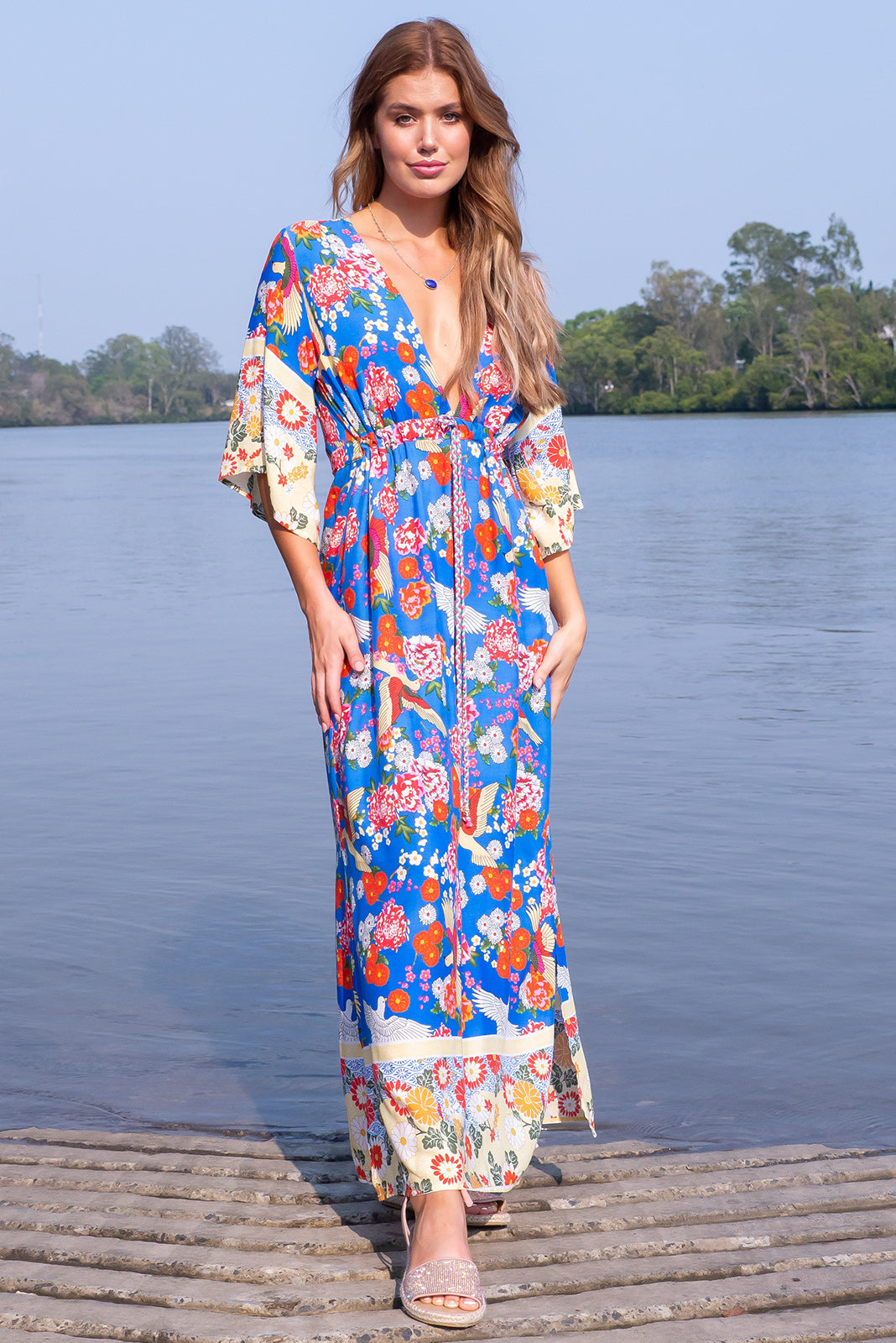Annabella Ming Bird Sky Caftan Maxi Dress, bohemian summer style, 100% rayon, deep v neckline, side pockets, front drawstring waist, elasticated waist back, braided multicoloured drawstring tassels and beading, deep sky blue base with red, gold and white bird and floral design, striped border pattern.