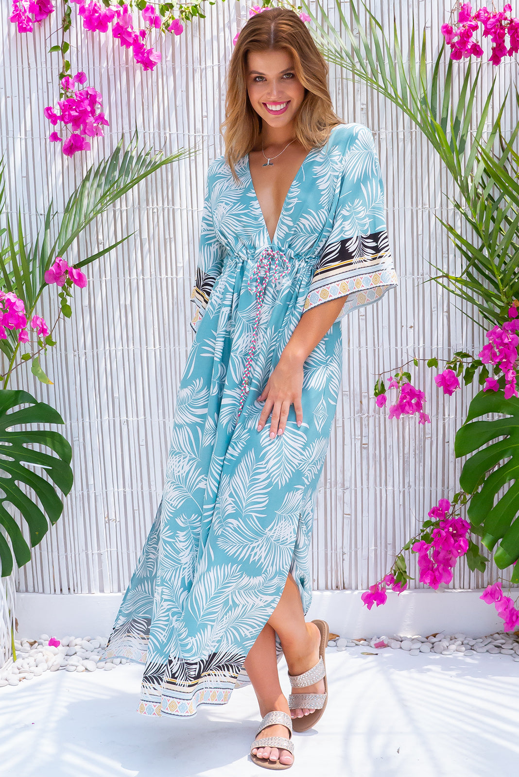 Annabella Palm Reading Caftan Maxi Dress, bohemian summer style, 100% rayon, adjustable drawstring waist, braided multicoloured drawstring with tassels and beading, deep v neckline, side pockets, sky blue base with large white palm print and complimentary multicoloured border print featuring white, black, sky blue, gold and fuchsia.