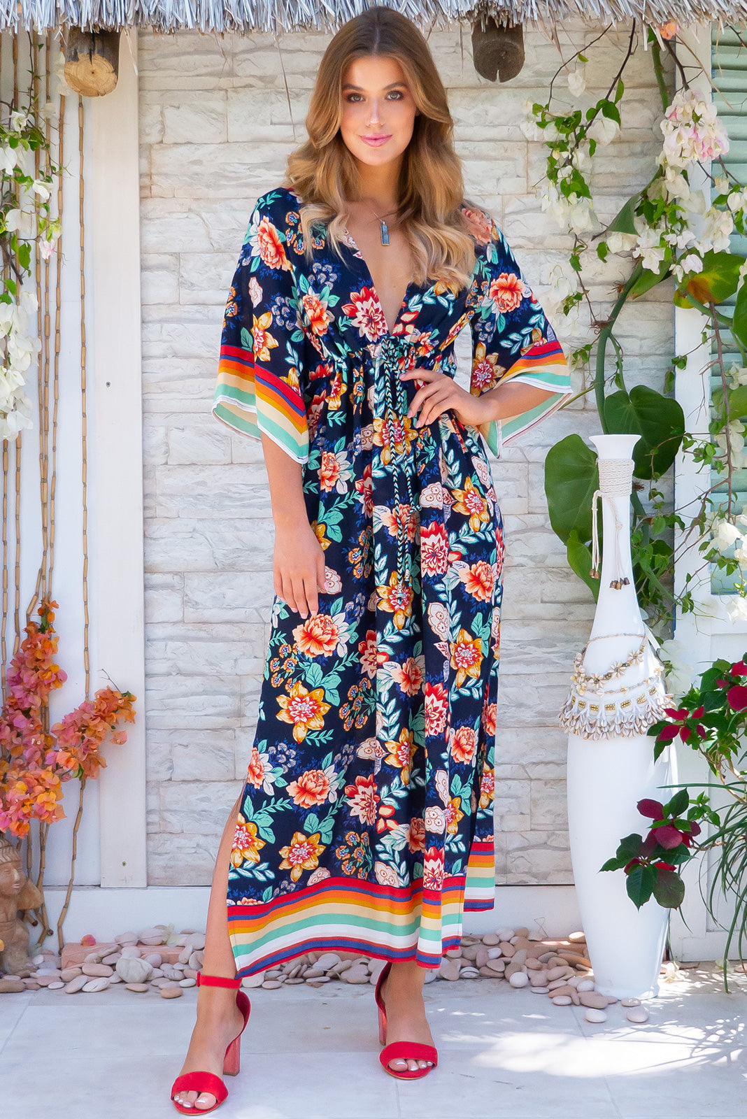 Annabella Roselina Navy Caftan Maxi Dress Colourful resort wear dress with tropical floral print and stripes, plunging neckline, drawstring waist and side pockets.