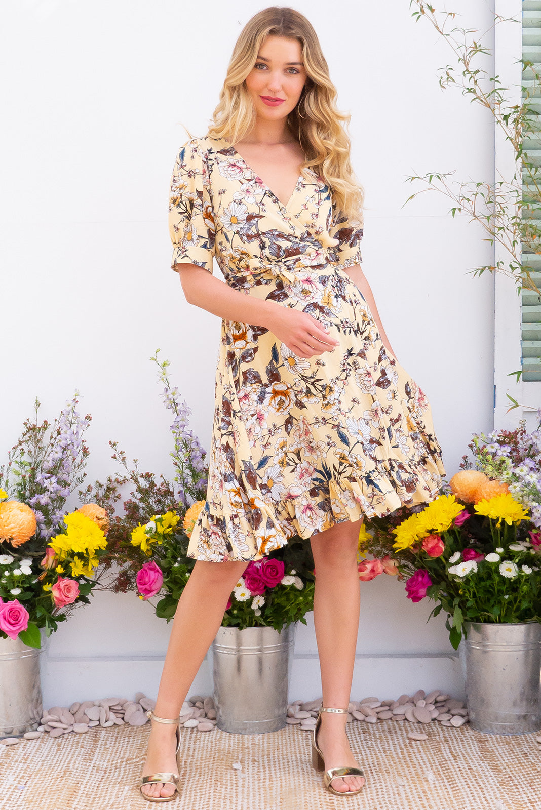 Antigua Mellow Yellow Maxi Wrap Dress in a 1940's inspired style with cuffed midi sleeves and a delicate hemline frill in a warm pastel yellow and tonal romantic floral print on crinkle woven rayon