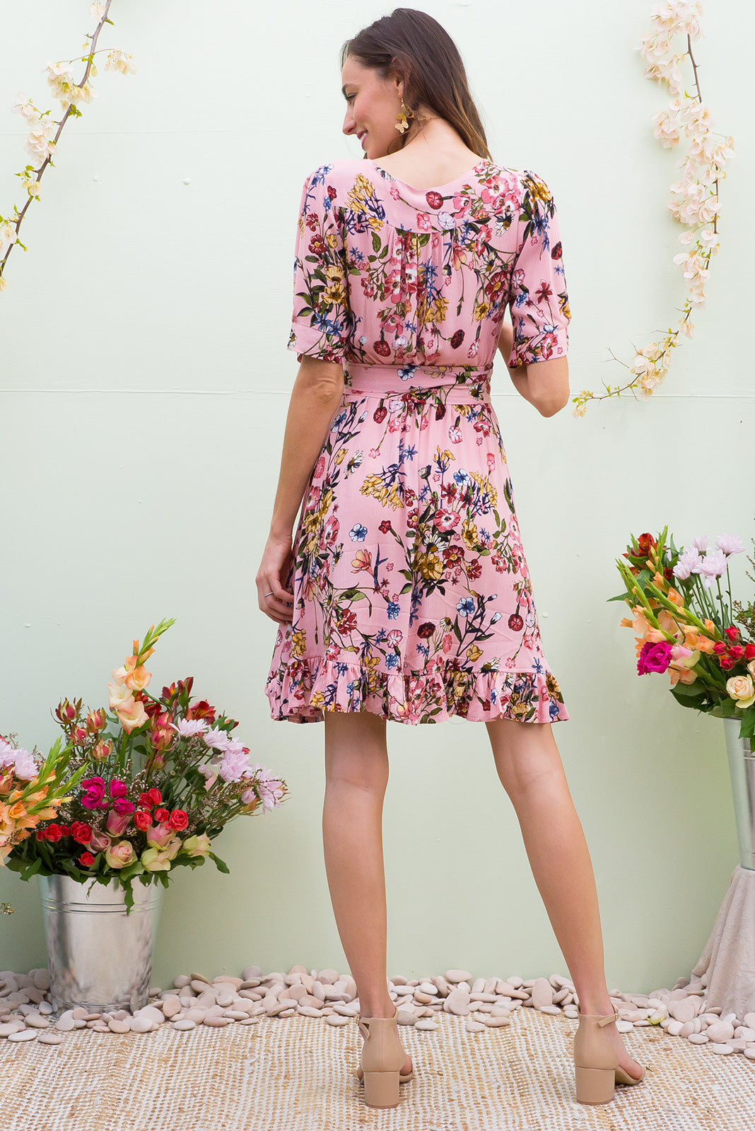 Antigua Pemberley Pink Maxi Wrap Dress in a 1940's inspired style with cuffed midi sleeves and a delicate hemline frill in a rose petal pink wildflower floral print on crinkle woven rayon