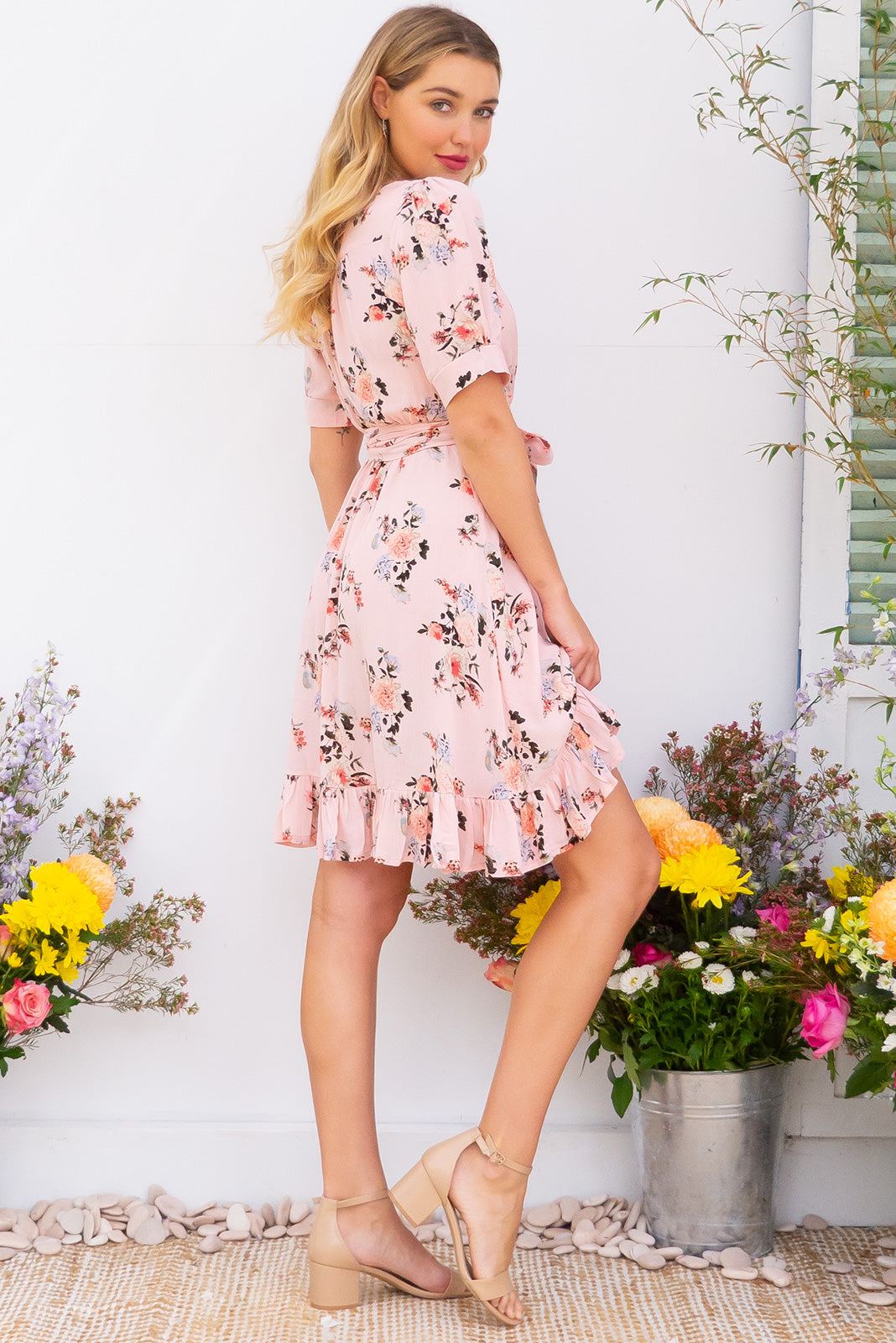 Antigua Pink Le Park Maxi Wrap Dress in a 1940's inspired style with cuffed midi sleeves and a delicate hemline frill in a rose petal pink bouquet floral print on crinkle woven rayon