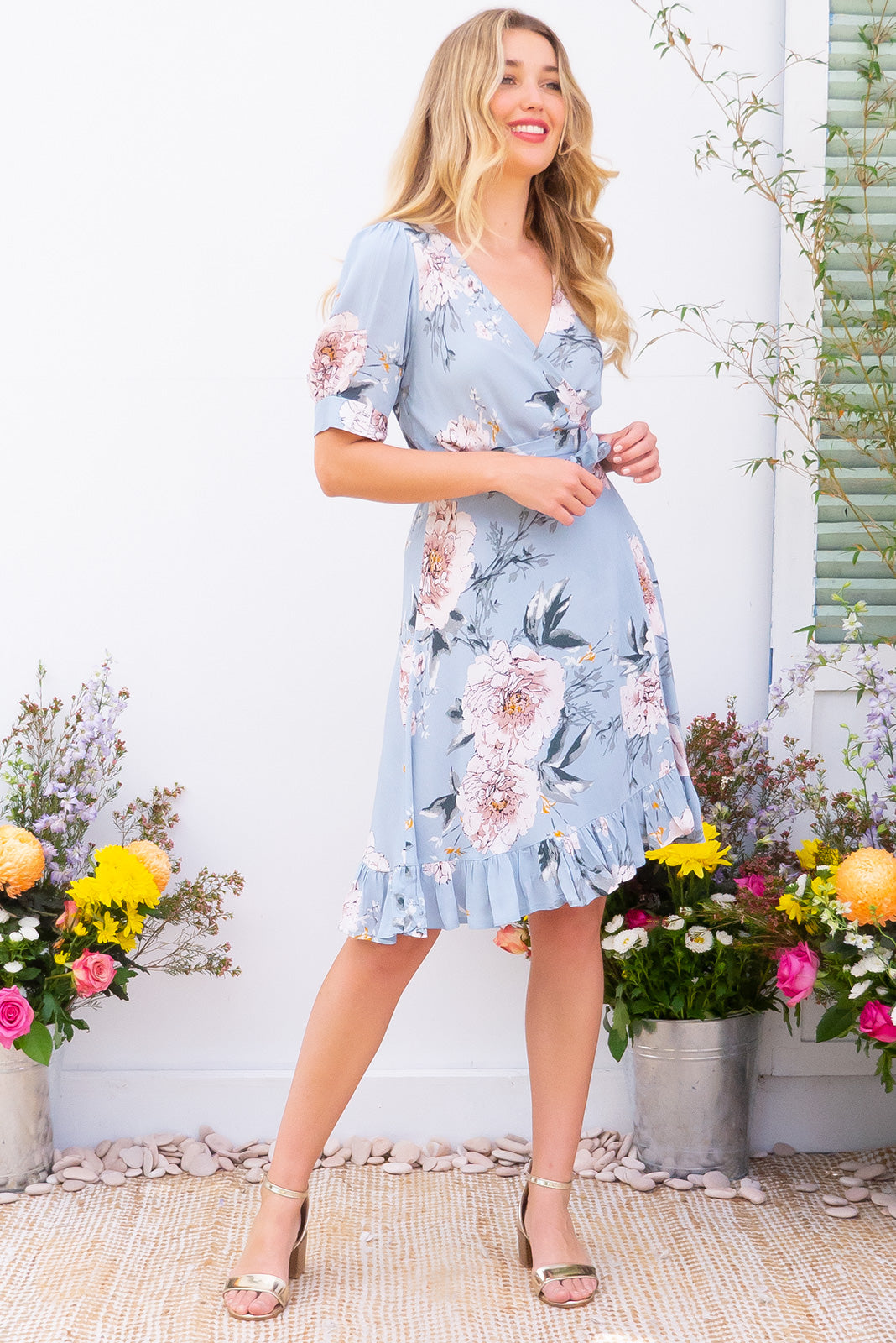 Antigua Powder Blue Maxi Wrap Dress in a 1940's inspired style with cuffed midi sleeves and a delicate hemline frill in a pastel steel blue and tonal romantic floral print on crinkle woven rayon