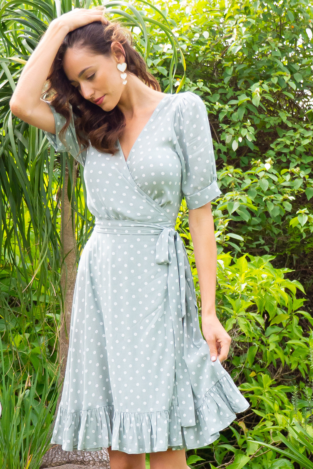 Antigua Sage Green Maxi Wrap Dress in a 1940's inspired style with cuffed midi sleeves and a delicate hemline frill in a pastel sage green spot print on crinkle woven rayon