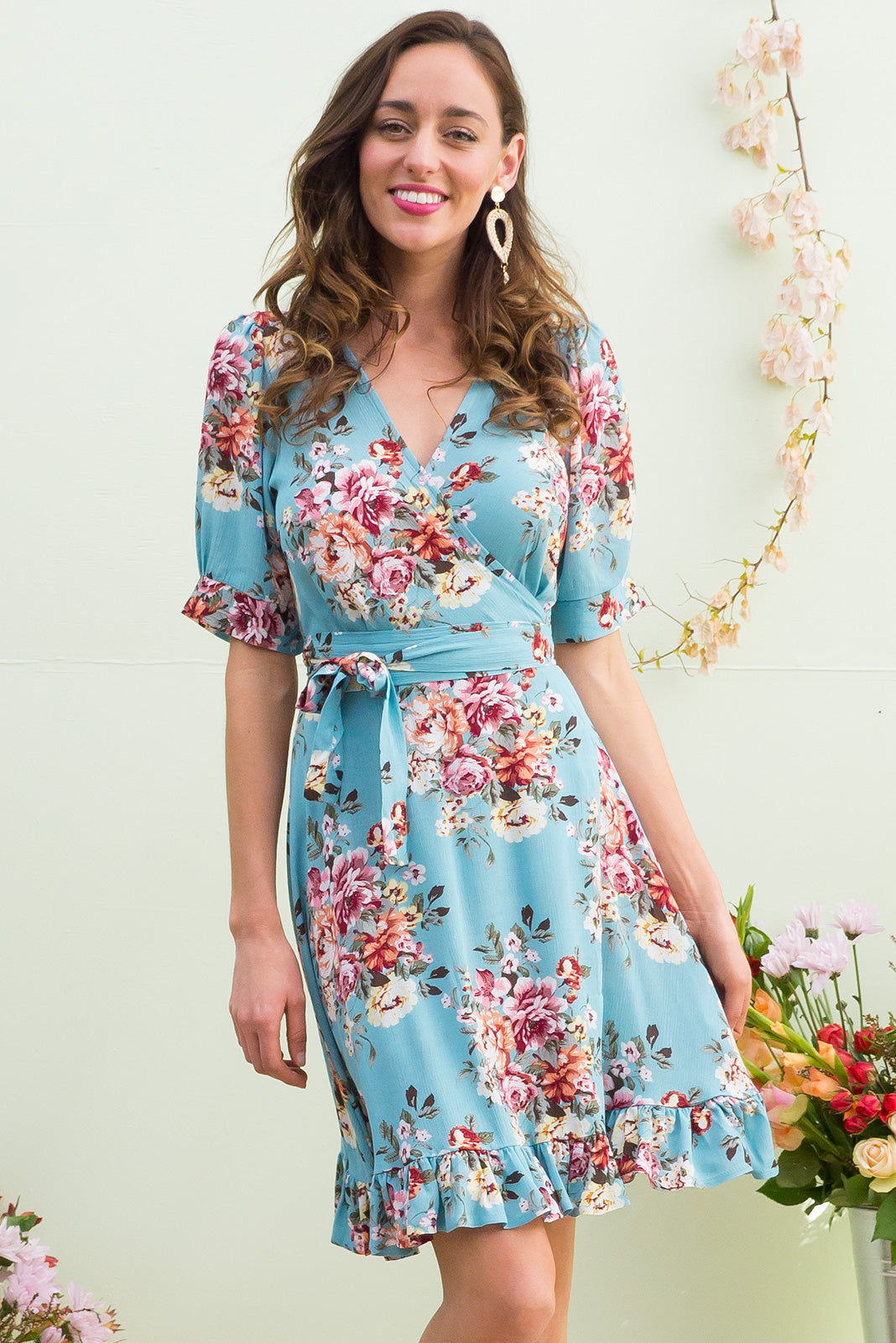 Antigua Summerhouse Blue Maxi Wrap Dress in a 1940's inspired style with cuffed midi sleeves and a delicate hemline frill in a sea foam blue and romantic rose floral print on crinkle woven rayon