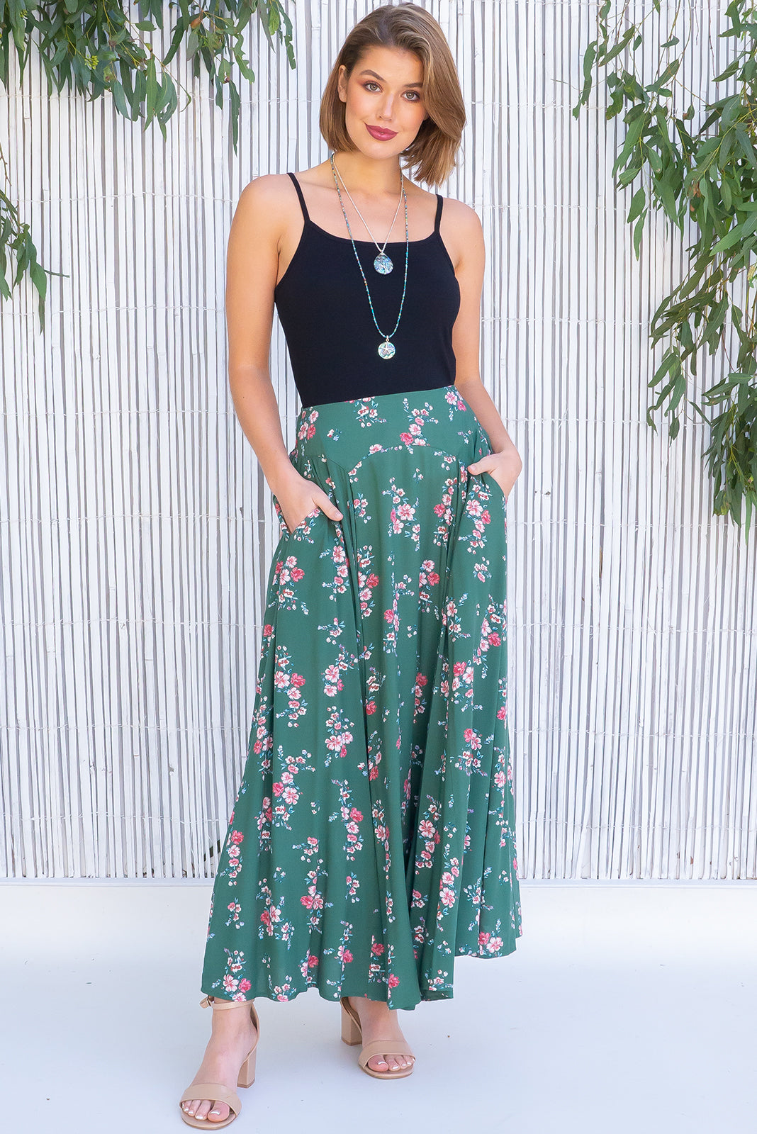 Atlantis Galway Green Maxi Skirt features double V-shaped waist yoke, inset panels from the yoke down, elasticated & ruched back of waist, side pockets, shapely hemline and woven 100% viscose in soft green base with pink floral print.