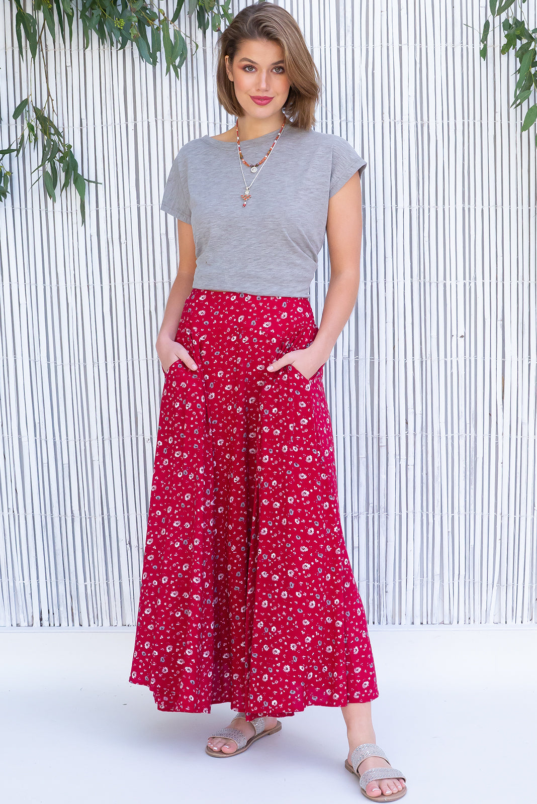 Atlantis Paso Doble Red Maxi Skirt features double V-shaped waist yoke, elasticated back of waist, side pockets, shapely hemline and woven 100% viscose in rich red base with simple floral print.