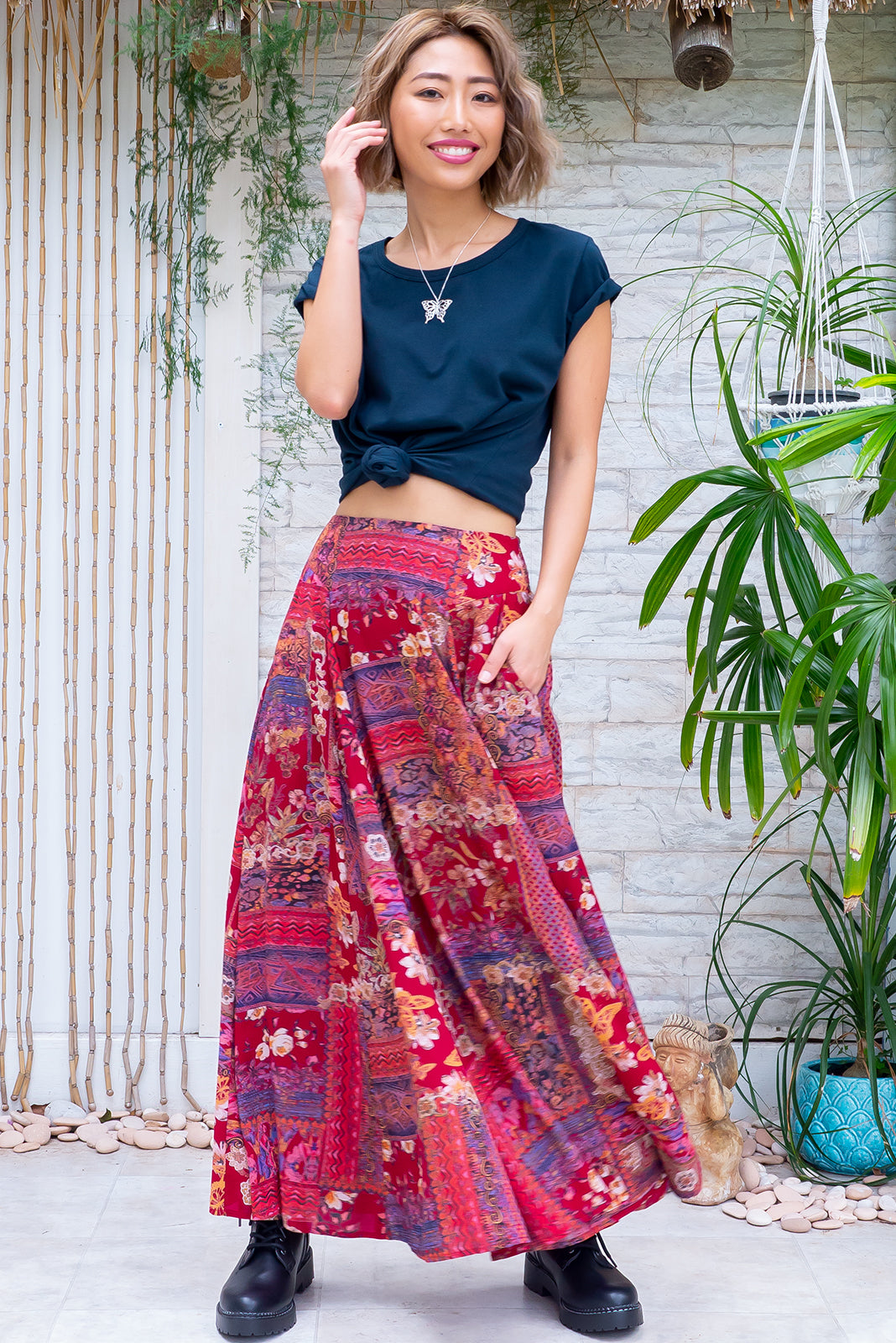 The Atlantis Red Renaissance Maxi Skirt features double V-shaped waist yoke, inset panels from the yoke down, elasticated & ruched back of waist, side pockets, shapely hemline and 100% viscose in retro, red 80's inspired patchwork print.