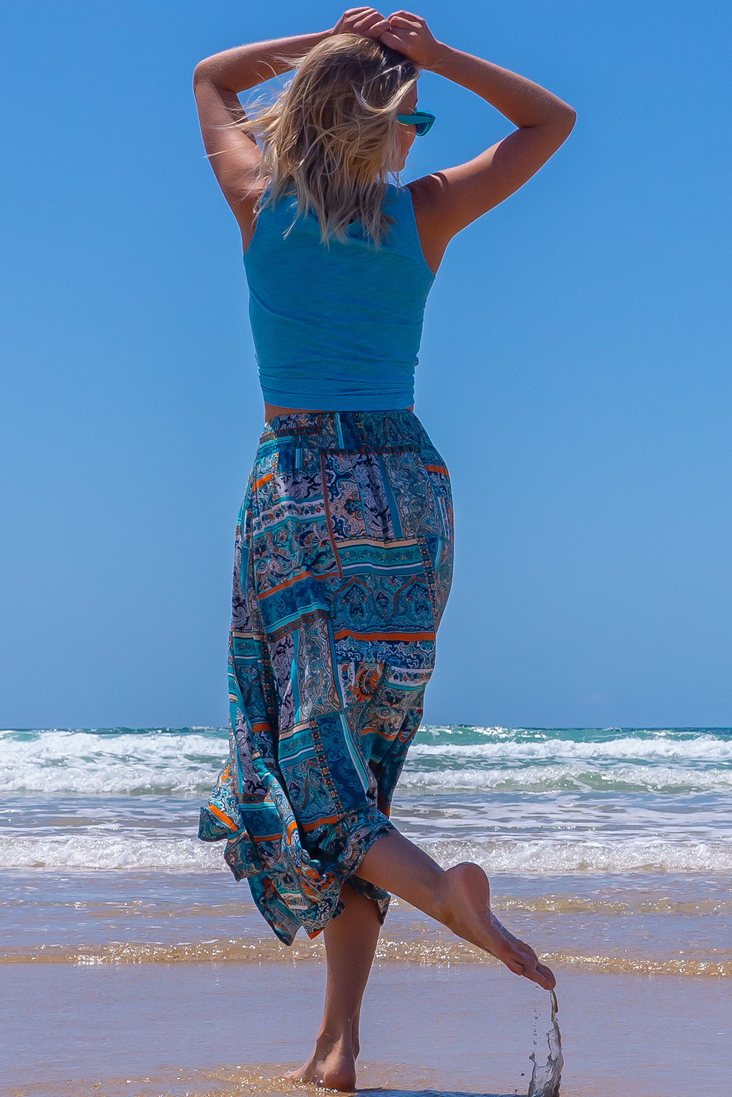 The Atlantis Tetouan Teal Maxi Skirt features double V-shaped waist, elasticated & ruched back of waist, side pockets, shapely hemline and 100% viscose in turquoise, white, beige and orange paisley print.