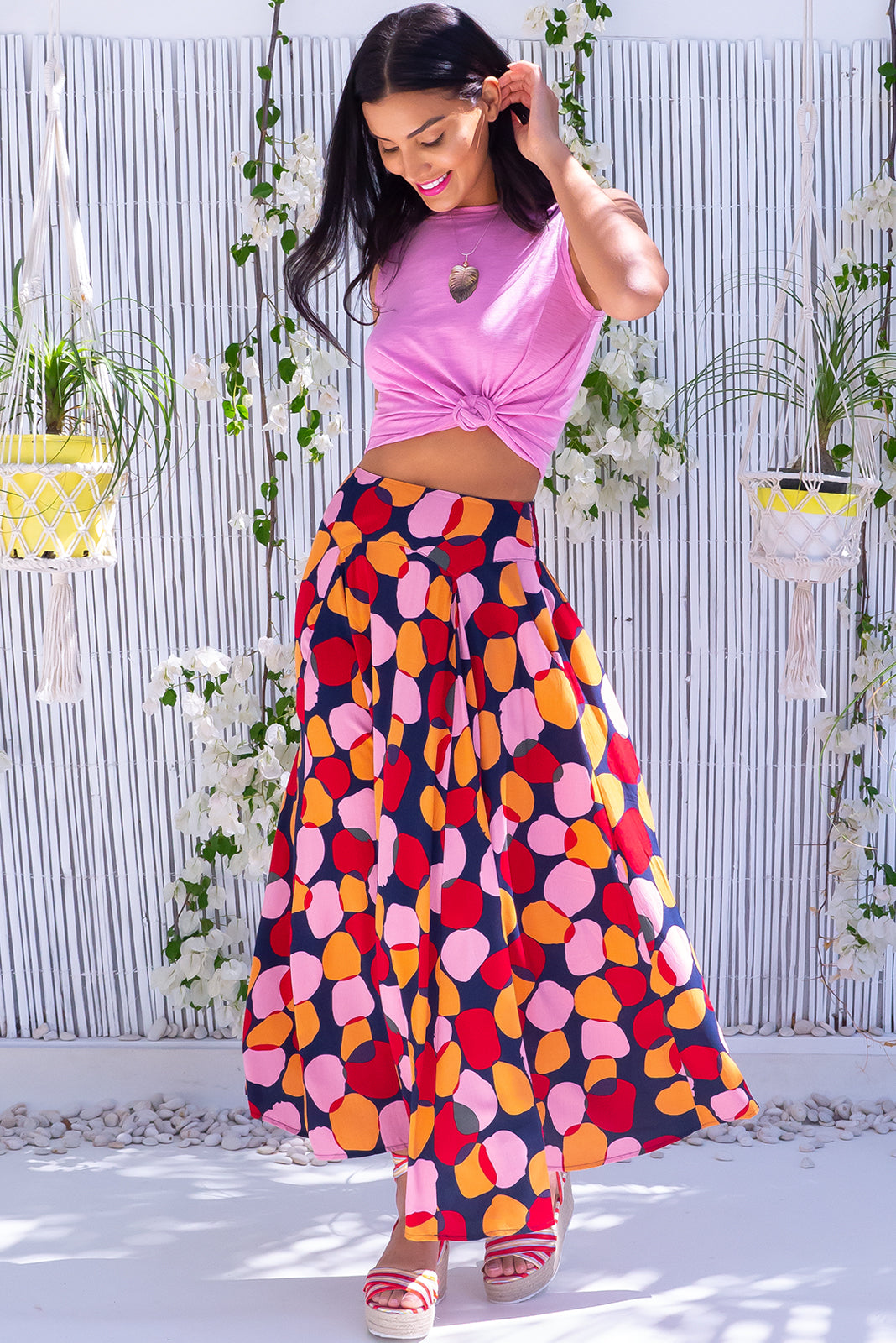 The Atlantis Zinzi Spot Maxi Skirt features double V-shaped waist yoke, side pockets and 100% viscose in ink base with pink, orange and red spots.