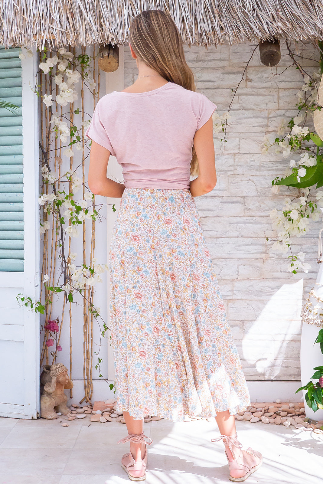 Avalon Milk & Honey Skirt, bohemian summer style, 100% rayon, deep side pockets, elasticated waist with belt loops, off-white base with small pastel pink, blue, soft gold and cream floral print.