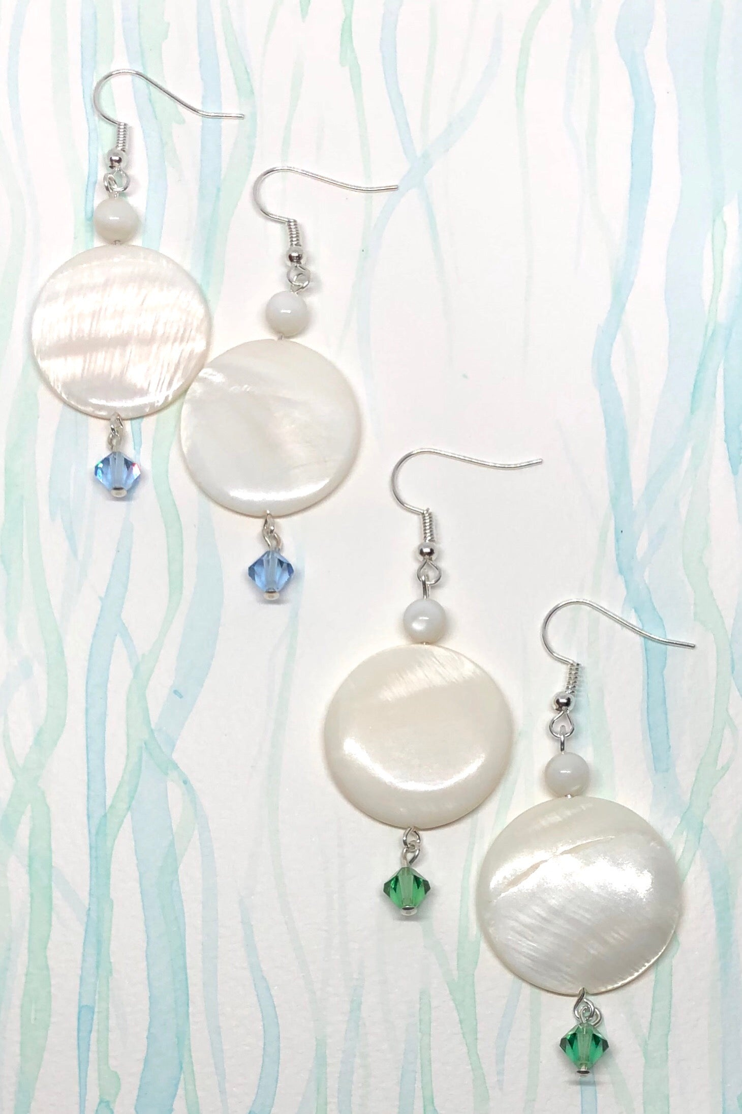 Mother of pearl sea shell earrings features cut Swarovski Crystal bead in sea blue or seaweed green, Boho Luxe beach style.