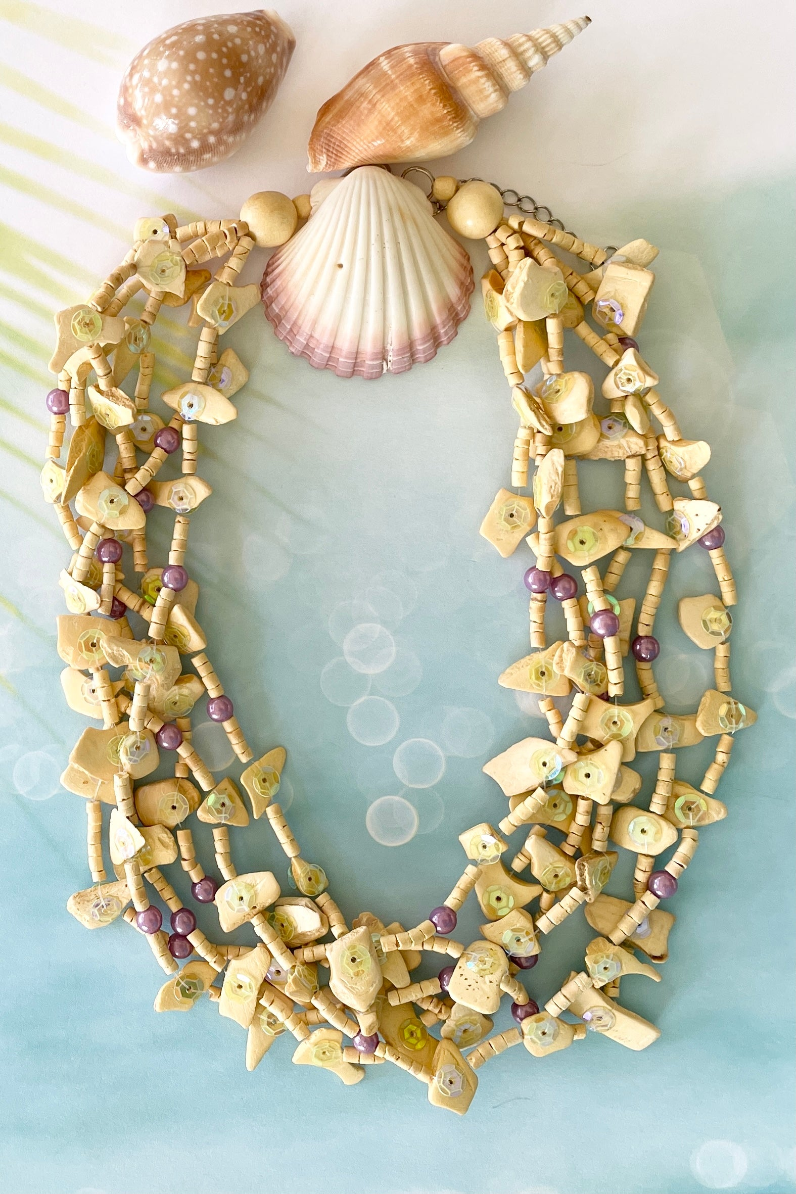 Necklace  Blu Mauve bead Beach is made from small hand cut wooden beads in pale creamy yellow.