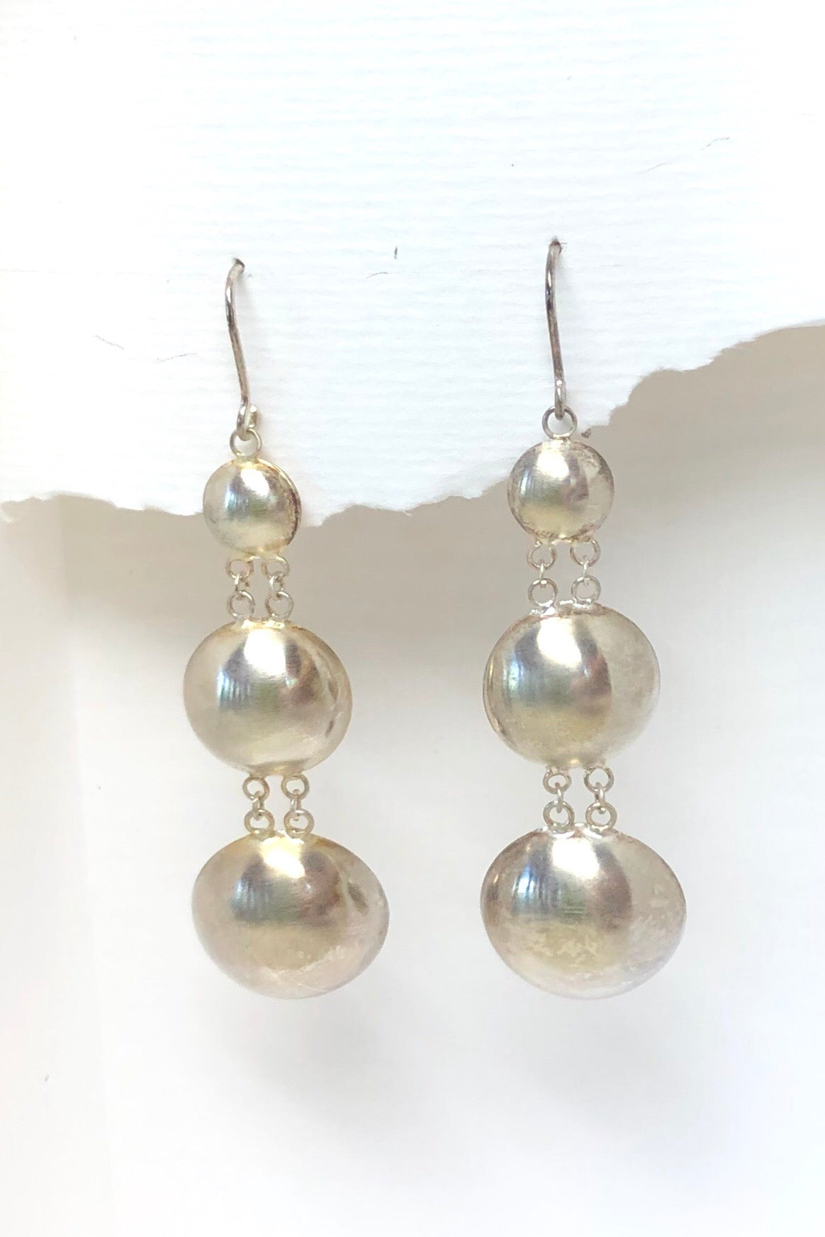 silver earrings in dome shape