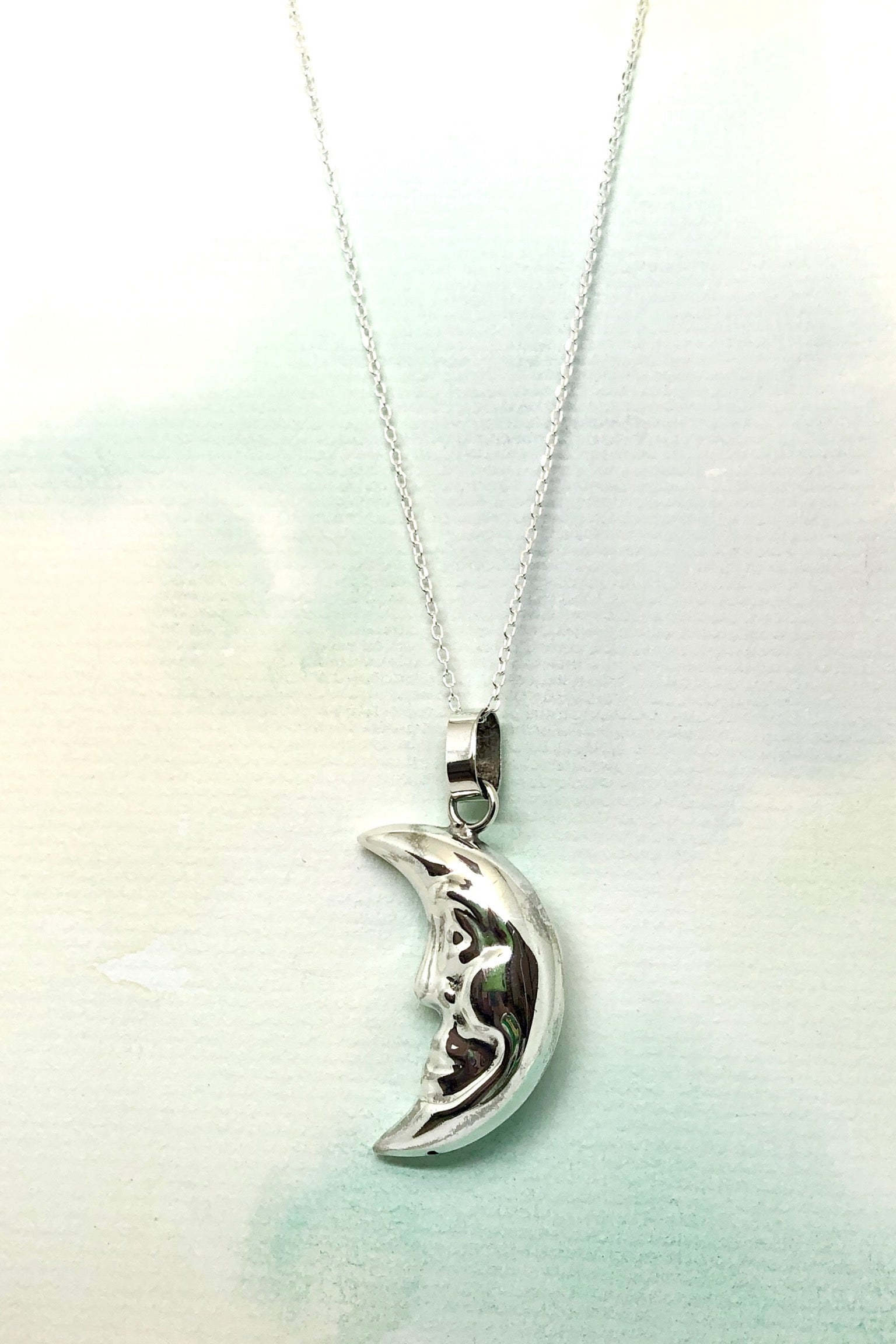 This Echo Man in the Moon Pendant is a vintage 925 silver pendant featuring a faced moon.