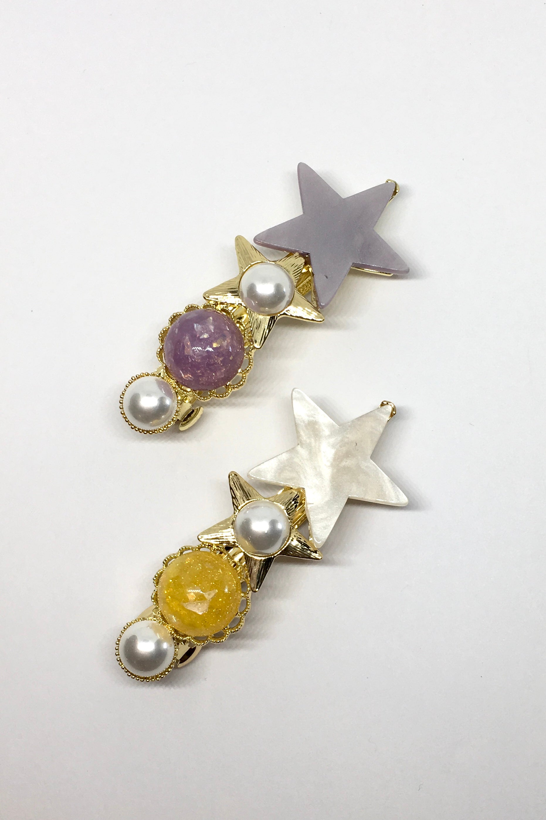 Womens hair accessories. 90s inspired hair clips. Shooting star design of marble stars and beads. Available in purple or yellow. Super cute and quirky.