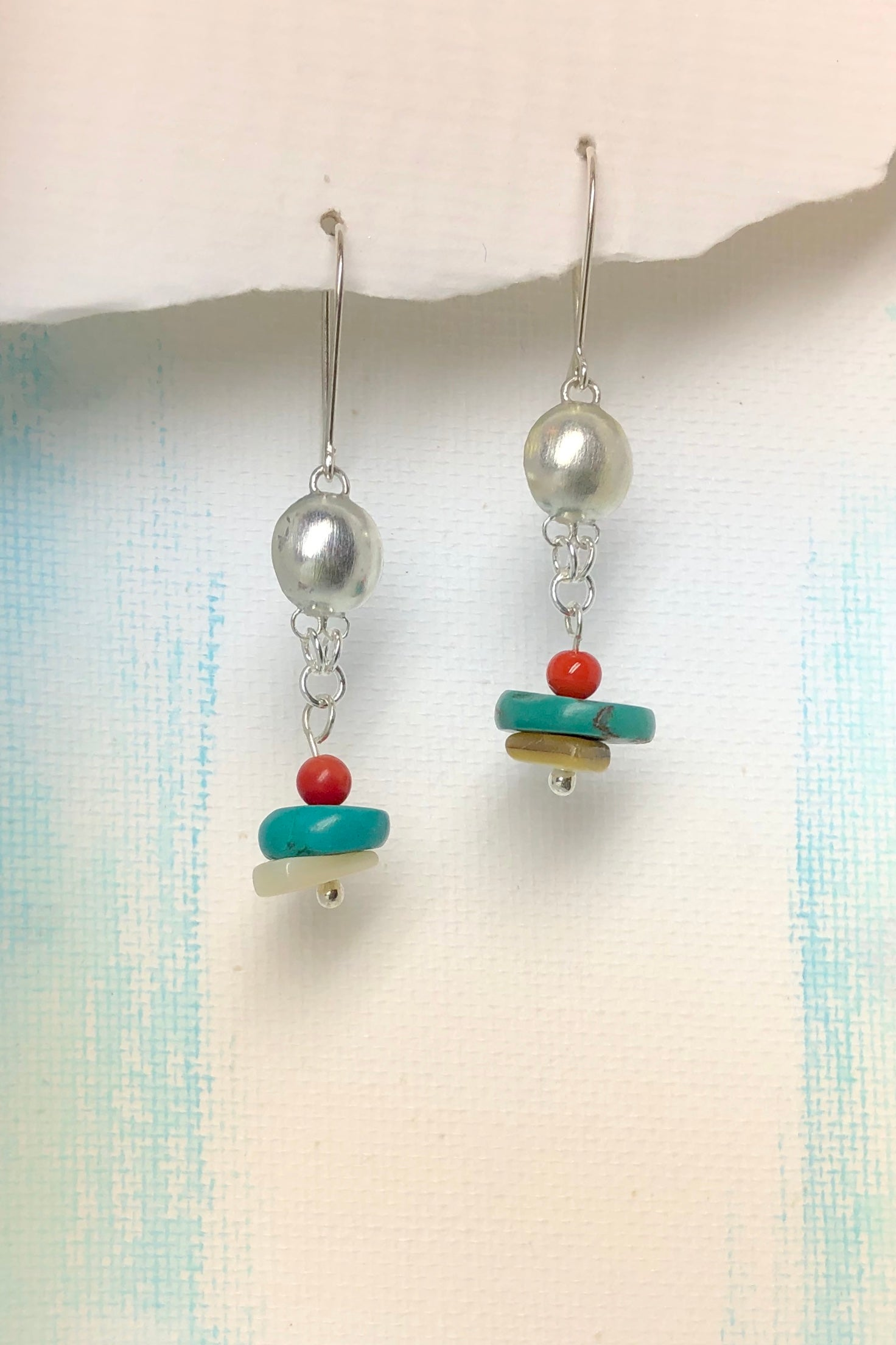 The Serendipity Earrings Turquoise Dome are handmaden Noosa, Australia featuring Natural Turquoise, Coral and Shell and the hook is 925 Silver.