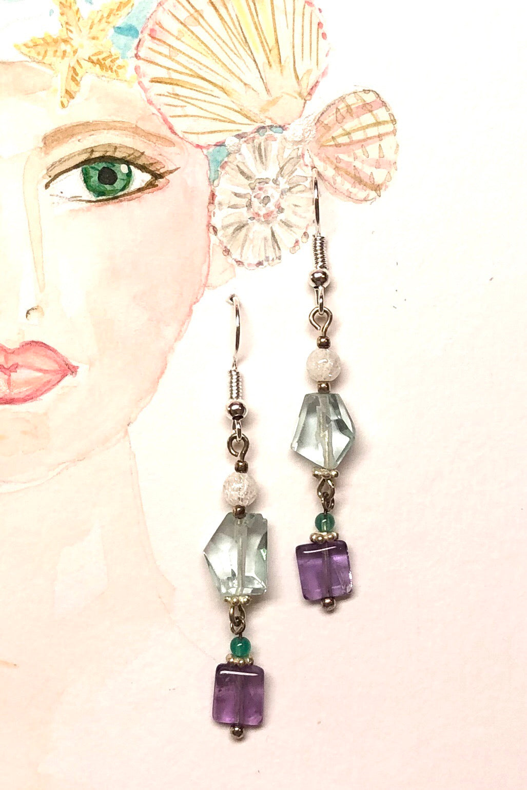 The Serendipity Earrings are handmade earrings in soft blues, and amethyst gemstones featuring 5.2cm long total and some stones are village cut.